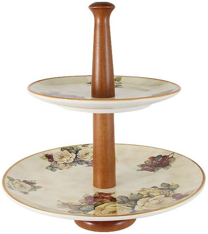 Двухъярусная ваза для фруктов LCS Роза и малина, высота 33 см54161Двухъярусная ваза для фруктов h33см Роза и малина LCS - молодая, динамично развивающаяся итальянская компания из Флоренции, производящая разнообразную керамическую посуду и изделия для украшения интерьера. В своих дизайнах LCS использует как классические, так и современные тенденции. Высокий стандарт изделий обеспечивается за счет соединения высоко технологичного производства и использования ручной работы профессиональных дизайнеров и художников, работающих на фабрике.