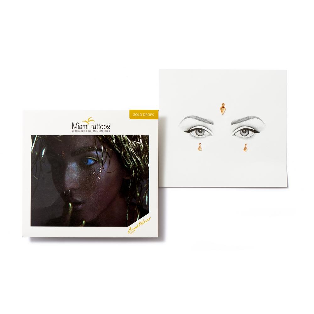 Miami Tattoos Клеящиеся кристаллы для лица Crystalzzz Drops in Gold, 1 лист 15см*16смMT0054Miami Tattoos - это дизайнерские переводные тату-украшения. Коллекция кристаллов Crystalzzz — это модный аксессуар для вашей кожи, который наносится за считанные секунды. Больше вам не нужна помощь визажиста, чтобы создать необычный макияж. Просто отклейте кристаллы от прозрачной пленки и приклейте их на чистую кожу. Crystalzzz можно наносить как на лицо, так и на тело. Они не вызывают аллергию и абсолютно безопасны для кожи.