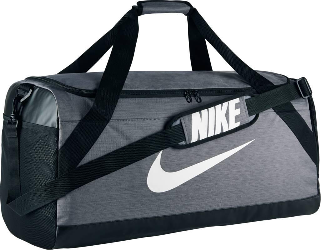 Сумка спортивная Nike Brasilia Large Duffel Bag, цвет: серый. BA5333-064BA5333-064Сумка-дафл Nike Brasilia (большой размер) выполнена из невероятно прочной ткани для переноски спортивной экипировки. Внутренние карманы помогают держать вещи в порядке, а отделение для обуви позволяет хранить влажную экипировку отдельно от сухой. Особенности: Прочная водонепроницаемая ткань дна защищает экипировку от влаги. Вместительное и универсальное основное отделение. Вентилируемое отделение для хранения влажной/сухой обуви. Водонепроницаемый полиэстер высокой плотности отличается прочностью. Универсальное вместительное основное отделение оснащено двойной молнией. Двойные ручки можно соединить вместе для удобного ношения. Мягкая плечевая лямка снимается и регулируется для комфортного ношения.