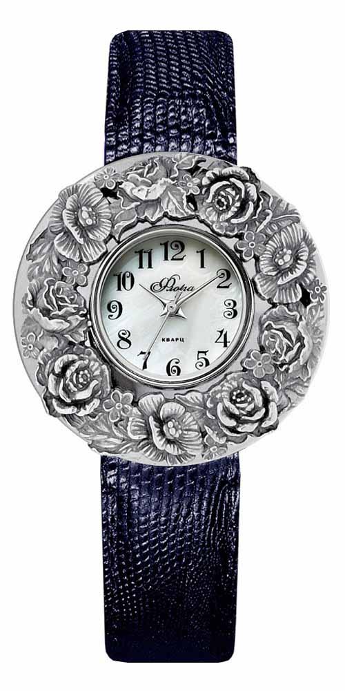 Часы наручные женские Mikhail Moskvin Флора, цвет: темно-синий, серебристый. 1143S10-В6L21143S10-В6L2Люксовая модель коллекции Mikhail Moskvin Флора изготовлена в изящном и немного загадочном стиле. Искусство ювелирного оформления - хрупкий индивидуальный процесс - был применен при изготовлении накладки из серебра 925 пробы средним весом 9,2 грамма. На перламутровом циферблате необычные арабские цифры органично сочетаются с изящными стрелками. В модели используется кварцевый высокоточный механизм производства Miyota Sitizen (Япония). Корпус, диаметром 36 мм, предлагается с черным ремешком из натуральной кожи и надежной пряжкой. Модель комплектуется дополнительным ремнем.
