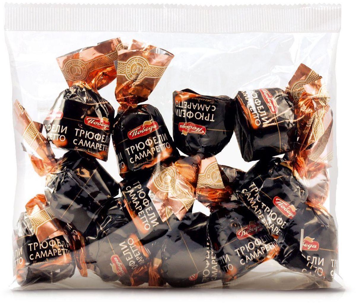 Победа вкуса Трюфели с амаретто шоколадные конфеты, 200 г541Трюфели с алкоголем от кондитерской фабрики Победа - премиум-десерт, созданный по классическому рецепту. Нежная трюфельная масса из сливок и шоколада пропитана амаретто и окружена нежной оболочкой из сливочного шоколада. Как и все разновидности трюфелей от кондитерской фабрики Победа, трюфели с алкоголем произведены из высококачественного сырья с применением современных технологий.
