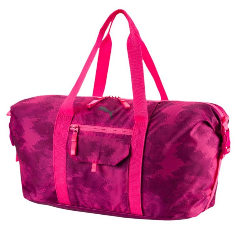 Сумка спортивная женская Puma Fit At Workout Bag, цвет: розовый. 0743740207437402Сумка Fit At Workout Bag создана для ценителей спорта. В ней удобно носить форму для тренировок, кроме того, она подойдет для путешествий. Большой основной карман дополнен маленькими отделениями для мелочей. С помощью боковых ремней можно регулировать объем сумки. У модели двухсторонняя застежка-молния основного отделения, сетчатый карман сбоку, карман на застежке-молнии спереди, карман для мелочей на застежке-липучке на верхней части, имеется отделение для крепления коврика для йоги. Рукоятки выполнены из тесьмы. Регулируемая по длине плечевая лямка. Тканые язычки у молний. Регулируемые ремни с пряжками по бокам для корректировки объема. Вышитый логотип бренда на передней части.