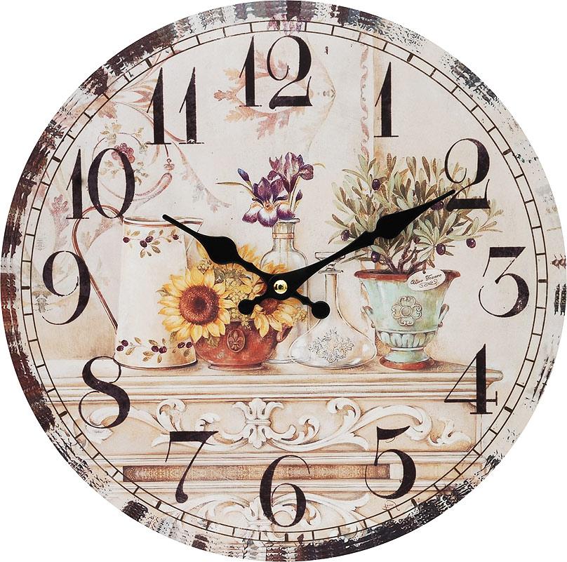 Часы настенные Белоснежка Цветы и олива, диаметр 34 см120-CLЦиферблат: открытый, выполнен из листа оргалита с декоративным покрытием. Стрелки металлические – часовая и минутная. Часовой механизм закрыт пластиковым корпусом. Питание от одного элемента питания стандарта АА. Отверстие для крепления часов на стену. Диаметр 34 см.