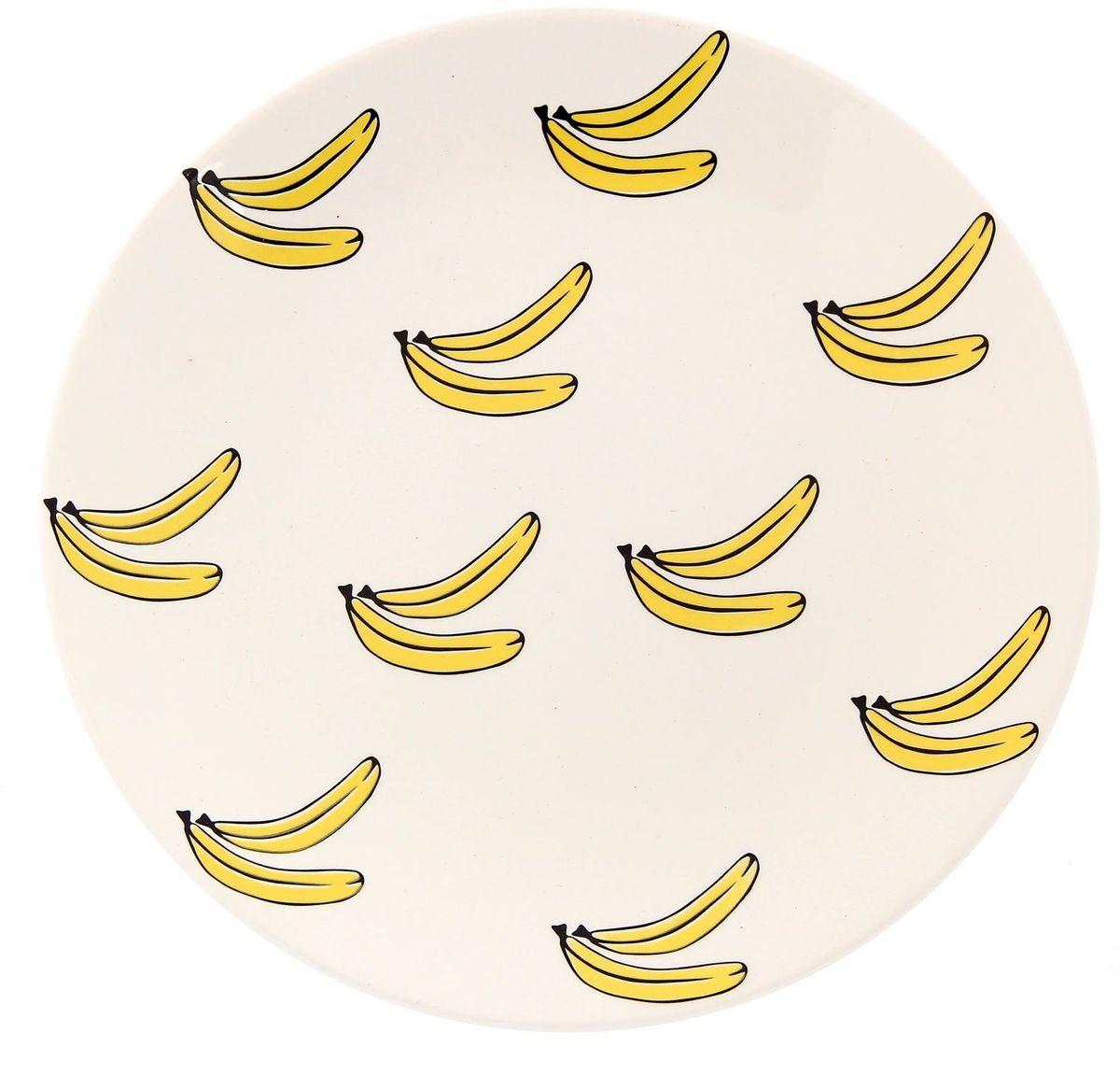Тарелка Сотвори чудо Бананы, диаметр 22 см2277885Хотите обновить интерьер кухни или гостиной? Устраиваете необычную фотосессию или тематический праздник? А может, просто ищете подарок для близкого человека? Посуда « Сотвори Чудо» — правильный выбор в любой ситуации. Её достоинства: изящный фаянс нежного сливочного цвета; стойкость краски; пригодность для посудомоечных машин.