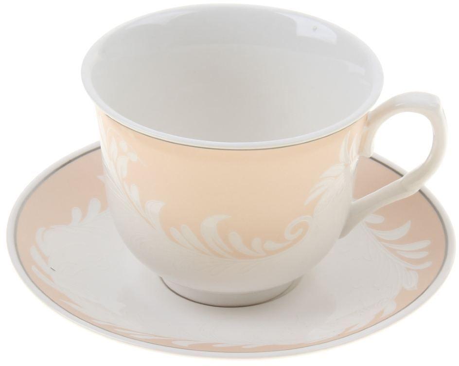 Чайная пара Доляна Мадлен, 2 предмета867802Какую посуду выбрать для чаепития? Конечно, традиционный напиток по необходимости можно пить и из помятой алюминиевой кружки. Но все-таки большинство хозяек стараются приобрести изящные и оригинальные модели для эстетического наслаждения неповторимым вкусом и тонким ароматом хорошего чая. Кухонная керамика сочетает в себе бытовую практичность и декоративную утонченность. Нарядный комплект обязательных для чаепития атрибутов изготовлен на родине древнего напитка и привнесет в каждую трапезу особую энергетику.