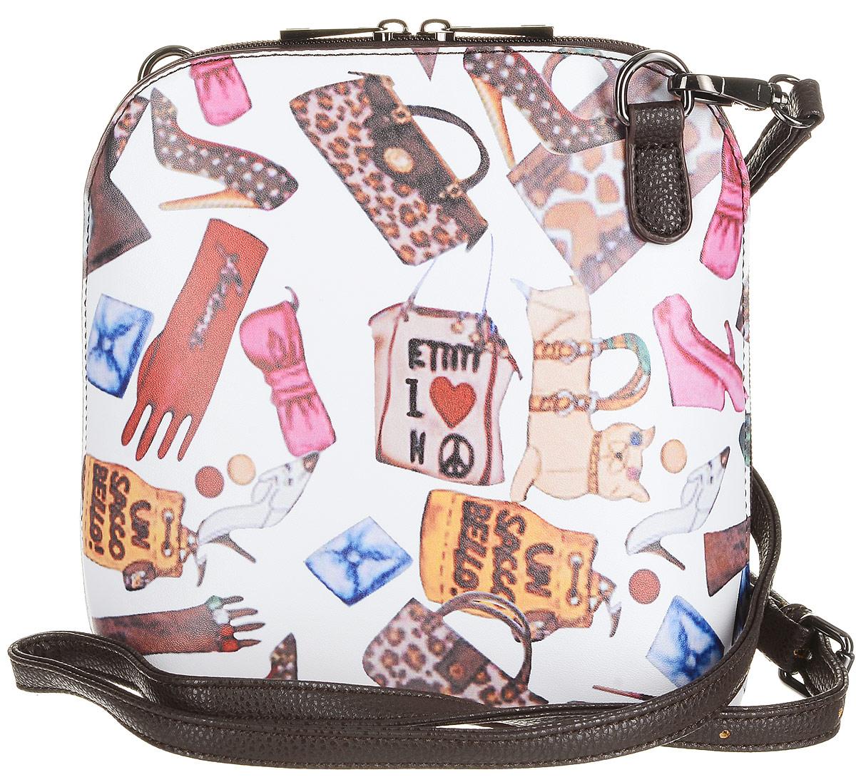 Сумка детская Vitacci, цвет: коричневый, белый. 21085-921085-9Детская стильная сумочка Vitacci выполнена из искусственной кожи. Сумка имеет одно вместительное отделение и застегивается на застежку-молнию. Внутри модель дополнена двумя втачными карманами на молнии и одним накладным открытым кармашком. Тыльная сторона сумки дополнена внешним карманом на застежке-молнии. Модель оформлена оригинальным принтом. Сумка оснащена съемным наплечным ремнем, который регулируется по длине.