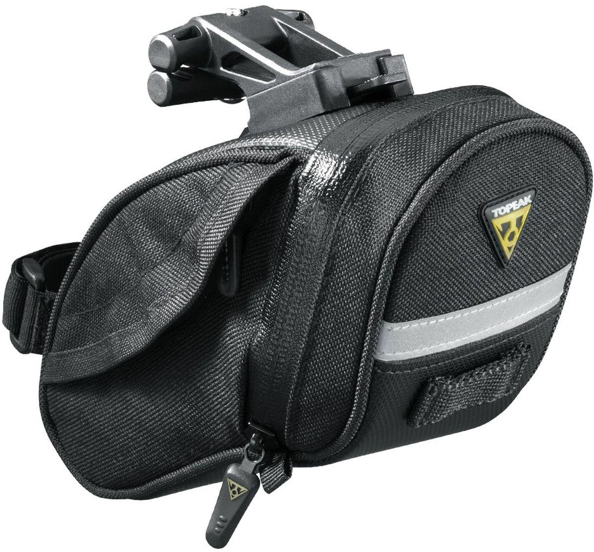 Сумка подседельная TOPEAK Aero Wedge Pack DX w/F25, с креплениемTC2269BПодседельная сумка Topeak Aero Wedge - это аэродинамичный модерн дизайн, не создающий препятствий встречному потоку и не влияющий на скорость. Конструктивно всё содержимое этой велосумки надёжно защищено и удерживает от соприкосновения с рамой и другими деликатными частями. Достаточно вместительная сумка для основных инструментов, которые могут потребоваться в дороге. Предназначается для горного велосипеда, актуальна как на короткие дистанции, так и в длительных велопоходах. Для безопасности в ночное время суток сумка оснащается светоотражающей полосой M3. Удобная велосумка, которая не раз выручит вас в пути! Материал: 1000 нейлон. Объем: 0.45 л. Вес: 125 г. Размер: 16 x 8.5 x 8.5 cм.