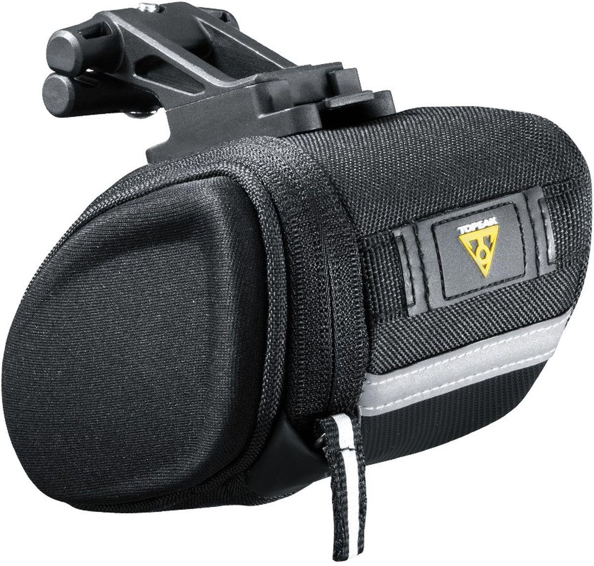 Сумка велосипедная TOPEAK SideKick Wedge Pack, с креплением F25TC2281BКрепления F25 TC2281B маленький Topeak. Новая конструкция плоской клиновидной сумки – формированные боковые стенки с гибкой и прочнейшей тканью посередине. Боковой отсек удобно расположен и позволяет легко получить доступ ко всему содержимому. Внутренние кармашки помогут Вам разместить ключи, набор инструментов или важные документы.