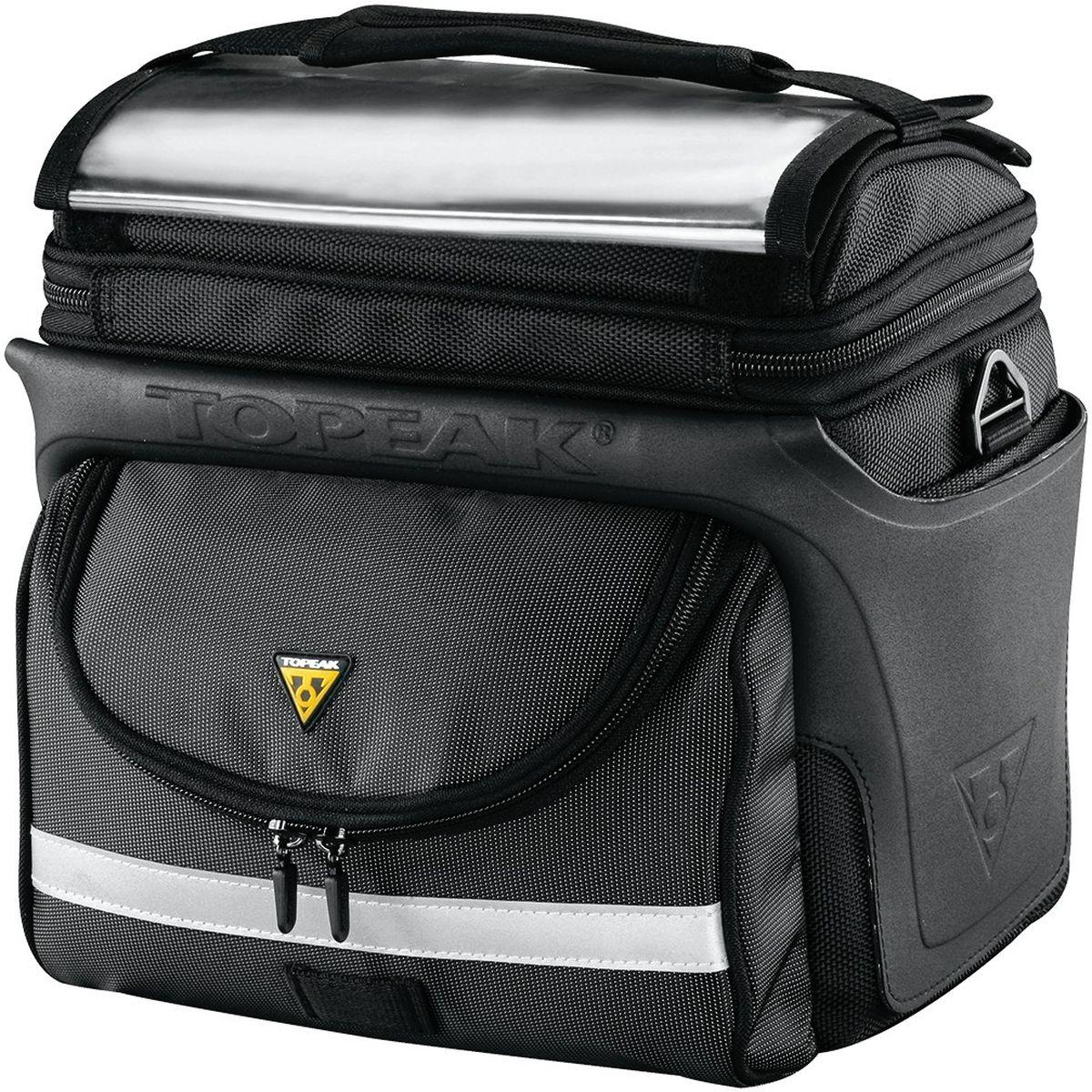 Велосумка на руль TOPEAK TourGuide Handlebar Bag DX, с креплениемTT3022BУдобная сумка Topeak TourGuide с быстросъёмным креплением, для длительных путешествий. Супер прочная и устойчивая к любым внешним условиям, многофункциональная сумка с системой QuickClick скрасит любую поездку, позволяя перевозить любые личные вещи. Отличается существенной вместимостью, при этом не мешает в поездке, позволяя удачно совмещать приятное с полезным. Дополнительное удобство обеспечивается разделением основного отделения дополнительными боковыми карманами на молнии. Мягкий наполнитель Eva выступает в качестве дополнительной защиты содержимого. Для безопасности в тёмное время суок предусмотрена светоотражающая полоска. Объем : 7.70 л. Вес: 1,23 кг. Размер: 27 x 21.5 x 26.6 см. Максимальная нагрузка: 5 кг.
