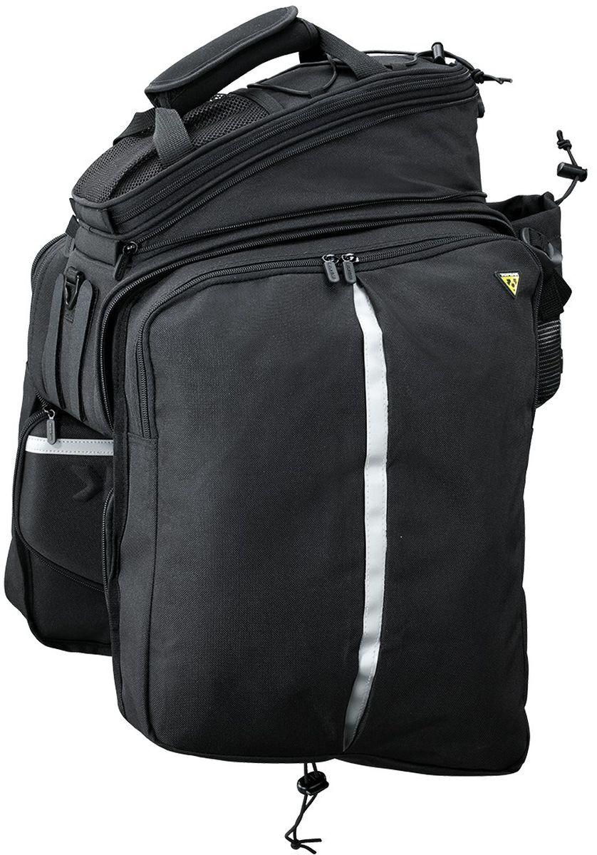Велосумка TOPEAK Trunk Bag DXP, с креплением на липучкеTT9643BСамая большая быстросъемная сумка в серии MTX trunkbag - модификация с универсальным креплением к любому багажнику с помощью лент-липучек. Все особенности линейки: придающие жесткость конструкции панели, прочная нейлоновая ткань, водонепроницаемая пропитка. Разделенный центральный отсек, двойной верхний карман, скрываемые боковые сумки. Наличие боковых рамок обязательно. Объем: 22.6 л. Особенности: отсек для бутылки, плечевой ремень, ручка для переноски, светоотражающий шнур 3M, петля для заднего фонаря. Размер: 36 x 25 x 21.5~29 см. Вес: 995 г. Артикул: TT9643B.