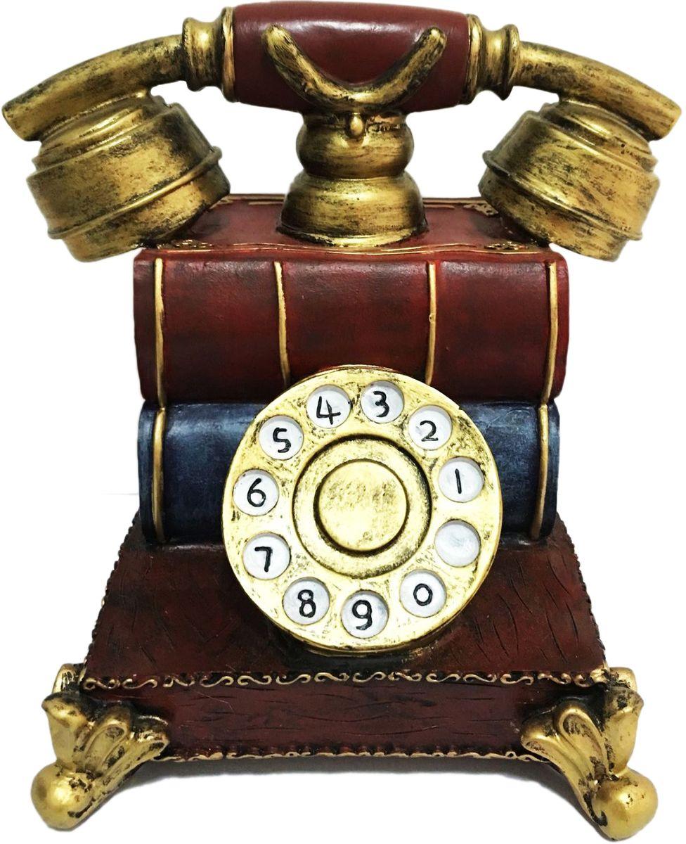 Копилка декоративная Magic Home Телефонный аппарат, 17 х 13,5 х 16 см44358Копилка декоративная Телефонный аппарат (из полирезины). Копилка станет отличным украшением интерьера вашего дома или офиса. Оснащена отверстием для монет и удобным клапаном на дне, через который можно достать деньги. Оригинальный дизайн сделает такую копилку прекрасным подарком. Она послужит не только по своему прямому назначению, но и красиво дополнит интерьер комнаты.