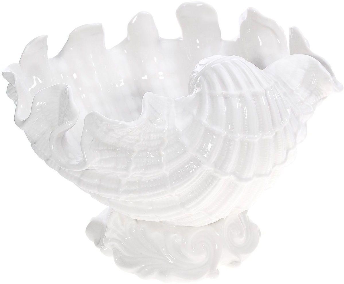 Чаша Lamart Ракушка, 19 х 27 х 26 см133174При взгляде на эту чашу возникает ощущение, что она вполне бы могла украшать собой пиршественный стол самого бога морей - Посейдона. Изящная Ракушка ручной работы, изготовленная из высококачественного фарфора, станет настоящим украшением обеденного стола и внесет приятное разнообразие в интерьер кухни или столовой. Она также будет прекрасным подарком для хозяйки дома, обладающей безукоризненным вкусом и ценящей стильные и эксклюзивные вещи. Заказать эту замечательную чашу вы можете на сайте нашего интернет-магазина буквально за несколько минут.