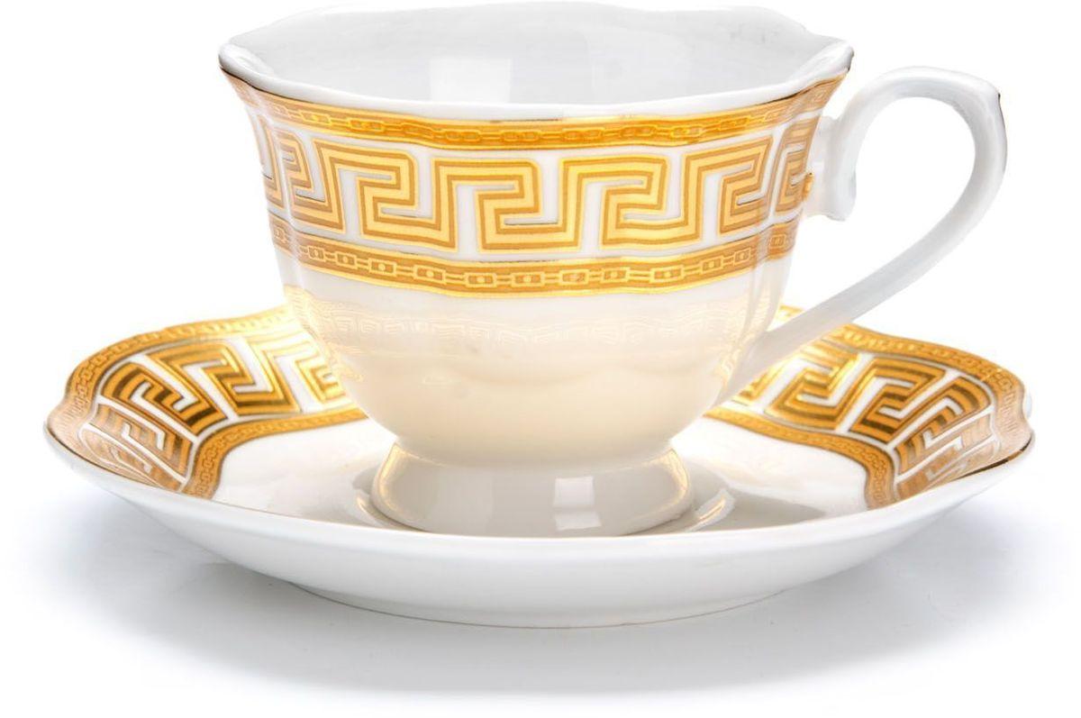 Кофейный сервиз Loraine, 80 мл, подарочная упаковка. 2643926439Кофейный сервиз Loraine на 6 персон выполнен из высококачественной керамики белого цвета и украшен широким золотым орнаментом в греческом стиле. Изящный дизайн придется по вкусу и ценителям классики, и тем, кто предпочитает утонченность и изысканность. Набор упакован в подарочную коробку. Каждый предмет надежно зафиксирован внутри коробки благодаря специальным выемкам. Кофейный набор - идеальный и необходимый подарок для вашего дома и для ваших друзей в праздники, юбилеи и торжества! Также он станет отличным корпоративным подарком и украшением любой кухни. В наборе: 6 кофейных чашек, 6 блюдец.