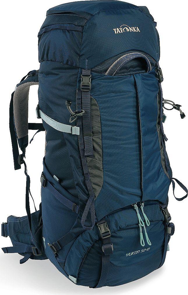 Рюкзак туристический женский Tatonka Yukon, цвет: темно-синий, 50+10 л1350.004Классический туристический рюкзак - идеальный выбор для разнообразных походов. Рюкзак оптимизирован для грузов среднего веса (до 20-25 кг), и представляет собой идеальный баланс легкости, прочности и комфорта. Система V2 совершенствовалась с годами, и всегда получала самые лучшие оценки как от профессионалов, так и от новичков. В обновленном рюкзаке отлично сочетаются и обновленная система переноски, и более тонкие, но прочные материалы, и максимальный комфорт при переноске рюкзака. Yukon оснащен 3D-входом в основное отделение, что делает более эффективным и быстрым процесс упаковки рюкзака. Дно рюкзака выполнено из прочного непромокаемого материала Cordura. Преимущества и особенности Система переноски V2 Разделенные верхнее и нижнее отделения Анатомиские лямки, адаптированные для девушек Фиксаторы для треккинговых палок или ледорубов Полностью адаптивная система настройки спины Компрессионные стропы по бокам Прочные ручки в передней и задней частях...