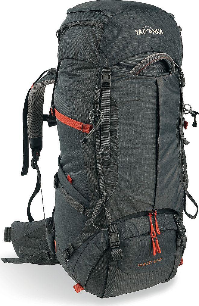 Рюкзак туристический женский Tatonka Yukon, цвет: темно-серый, 50+10 л1350.021Классический туристический рюкзак - идеальный выбор для разнообразных походов. Рюкзак оптимизирован для грузов среднего веса (до 20-25 кг), и представляет собой идеальный баланс легкости, прочности и комфорта. Система V2 совершенствовалась с годами, и всегда получала самые лучшие оценки как от профессионалов, так и от новичков. В обновленном рюкзаке отлично сочетаются и обновленная система переноски, и более тонкие, но прочные материалы, и максимальный комфорт при переноске рюкзака. Yukon оснащен 3D-входом в основное отделение, что делает более эффективным и быстрым процесс упаковки рюкзака. Дно рюкзака выполнено из прочного непромокаемого материала Cordura. Преимущества и особенности Система переноски V2 Разделенные верхнее и нижнее отделения Анатомиские лямки, адаптированные для девушек Фиксаторы для треккинговых палок или ледорубов Полностью адаптивная система настройки спины Компрессионные стропы по бокам Прочные ручки в передней и задней частях...