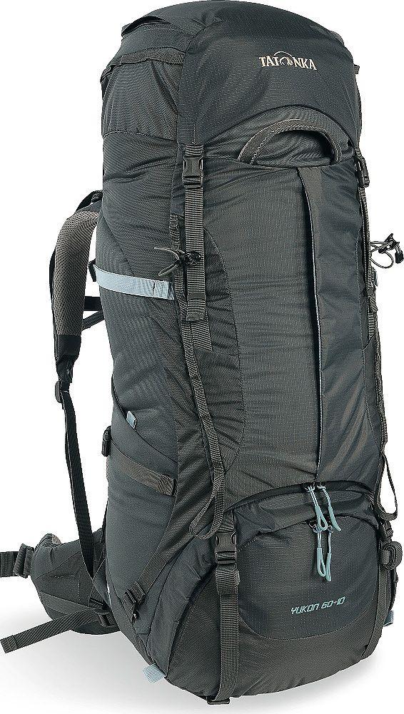 Рюкзак туристический женский Tatonka Yukon, цвет: темно-серый, 60+10 л1351.021Классический туристический рюкзак - идеальный выбор для разнообразных походов. Рюкзак оптимизирован для грузов среднего веса (до 20-25 кг), и представляет собой идеальный баланс легкости, прочности и комфорта. Система V2 совершенствовалась с годами, и всегда получала самые лучшие оценки как от профессионалов, так и от новичков. В обновленном рюкзаке отлично сочетаются и обновленная система переноски, и более тонкие, но прочные материалы, и максимальный комфорт при переноске рюкзака. Yukon оснащен 3D-входом в основное отделение, что делает более эффективным и быстрым процесс упаковки рюкзака. Дно рюкзака выполнено из прочного непромокаемого материала Cordura. Преимущества и особенности Система переноски V2 Разделенные верхнее и нижнее отделения Анатомиские лямки, адаптированные для девушек Фиксаторы для треккинговых палок или ледорубов Полностью адаптивная система настройки спины Компрессионные стропы по бокам Прочные ручки в передней и задней...