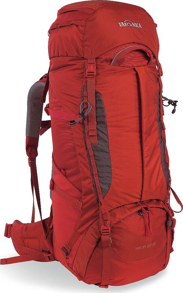 Рюкзак туристический женский Tatonka Yukon, цвет: красный, 60+10 л1351.254Классический туристический рюкзак - идеальный выбор для разнообразных походов. Рюкзак оптимизирован для грузов среднего веса (до 20-25 кг), и представляет собой идеальный баланс легкости, прочности и комфорта. Система V2 совершенствовалась с годами, и всегда получала самые лучшие оценки как от профессионалов, так и от новичков. В обновленном рюкзаке отлично сочетаются и обновленная система переноски, и более тонкие, но прочные материалы, и максимальный комфорт при переноске рюкзака. Yukon оснащен 3D-входом в основное отделение, что делает более эффективным и быстрым процесс упаковки рюкзака. Дно рюкзака выполнено из прочного непромокаемого материала Cordura. Преимущества и особенности Система переноски V2 Разделенные верхнее и нижнее отделения Анатомиские лямки, адаптированные для девушек Фиксаторы для треккинговых палок или ледорубов Полностью адаптивная система настройки спины Компрессионные стропы по бокам Прочные ручки в передней и задней...