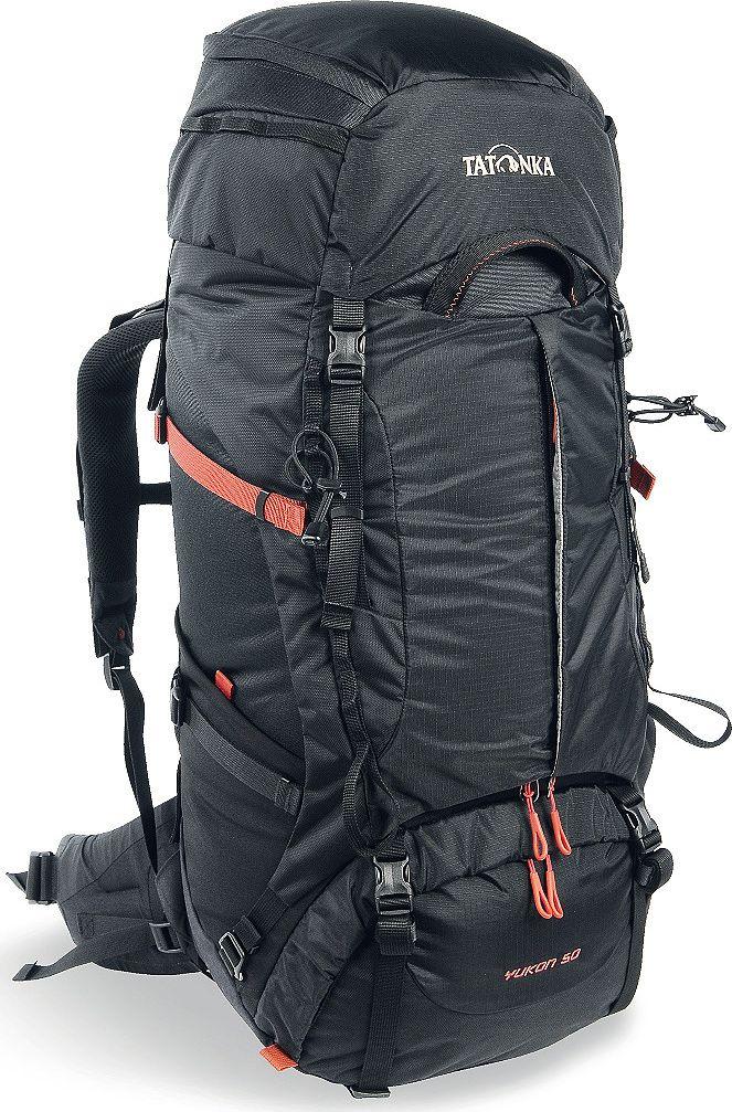 Рюкзак туристический Tatonka Yukon, цвет: черный, 50+10 л1352.040Классический туристический рюкзак - идеальный выбор для разнообразных походов. Рюкзак оптимизирован для грузов среднего веса (до 20-25 кг), и представляет собой идеальный баланс легкости, прочности и комфорта. Система V2 совершенствовалась с годами, и всегда получала самые лучшие оценки как от профессионалов, так и от новичков. В обновленном рюкзаке отлично сочетаются и обновленная система переноски, и более тонкие, но прочные материалы, и максимальный комфорт при переноске рюкзака. Yukon оснащен 3D-входом в основное отделение, что делает более эффективным и быстрым процесс упаковки рюкзака. Дно рюкзака выполнено из прочного непромокаемого материала Cordura. Преимущества и особенности Система переноски V2 Разделенные верхнее и нижнее отделения Фиксаторы для треккинговых палок или ледорубов Полностью адаптивная система настройки спины Компрессионные стропы по бокам Прочные ручки в передней и задней частях рюкзака Прочные молнии размера 10 3D-вход в...