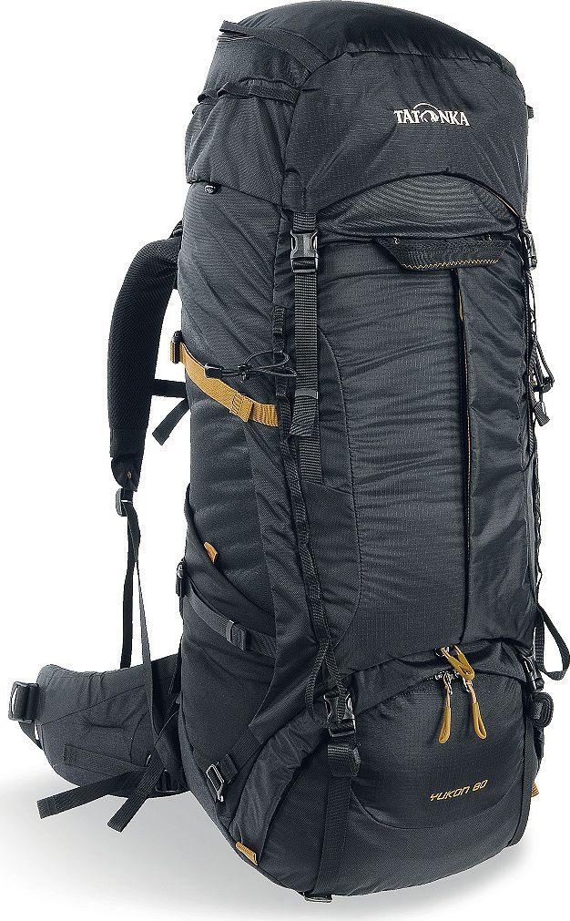 Рюкзак туристический Tatonka Yukon, цвет: черный, 60+10 л1353.040Классический туристический рюкзак - идеальный выбор для разнообразных походов. Рюкзак оптимизирован для грузов среднего веса (до 20-25 кг), и представляет собой идеальный баланс легкости, прочности и комфорта. Система V2 совершенствовалась с годами, и всегда получала самые лучшие оценки как от профессионалов, так и от новичков. В обновленном рюкзаке отлично сочетаются и обновленная система переноски, и более тонкие, но прочные материалы, и максимальный комфорт при переноске рюкзака. Yukon оснащен 3D-входом в основное отделение, что делает более эффективным и быстрым процесс упаковки рюкзака. Дно рюкзака выполнено из прочного непромокаемого материала Cordura. Преимущества и особенности Система переноски V2 Разделенные верхнее и нижнее отделения Фиксаторы для треккинговых палок или ледорубов Полностью адаптивная система настройки спины Компрессионные стропы по бокам Прочные ручки в передней и задней частях рюкзака Прочные молнии размера 10 ...