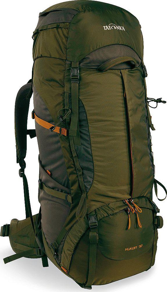 Рюкзак туристический Tatonka Yukon, цвет: оливковый, 70+10 л1354.331Классический туристический рюкзак - идеальный выбор для разнообразных походов. Рюкзак оптимизирован для грузов среднего веса (до 20-25 кг), и представляет собой идеальный баланс легкости, прочности и комфорта. Система V2 совершенствовалась с годами, и всегда получала самые лучшие оценки как от профессионалов, так и от новичков. В обновленном рюкзаке отлично сочетаются и обновленная система переноски, и более тонкие, но прочные материалы, и максимальный комфорт при переноске рюкзака. Yukon оснащен 3D-входом в основное отделение, что делает более эффективным и быстрым процесс упаковки рюкзака. Дно рюкзака выполнено из прочного непромокаемого материала Cordura. Преимущества и особенности Система переноски V2 Разделенные верхнее и нижнее отделения Фиксаторы для треккинговых палок или ледорубов Полностью адаптивная система настройки спины Компрессионные стропы по бокам Прочные ручки в передней и задней частях рюкзака Прочные молнии размера 10 ...