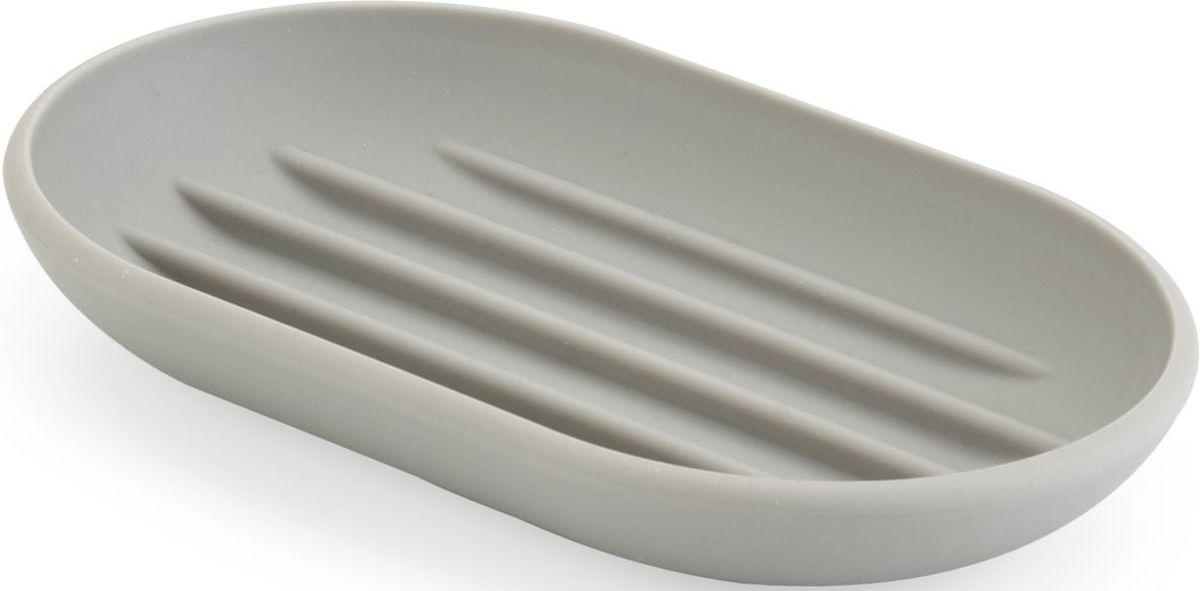 Мыльница Umbra Touch, цвет: серый, 2 х 13 х 9 см023272-918Функциональность мыльницы неоспорима - именно она защищает нашу раковину от мыльных подтеков и пятен. А как насчет дизайна? В Umbra уверены: такой простой и ежедневно используемый предмет должен выглядеть лаконично, но необычно. Ведь в небольшой ванной комнате не должно быть ничего вызывающе яркого. Немного экспериментировав с формой, дизайнеры создали мыльницу Touch, которая придется кстати в любом доме! Изготовлена из приятного на ощупь пластика, не скользит, а брать из нее мыло удобнее благодаря специальным желобкам на донышке.
