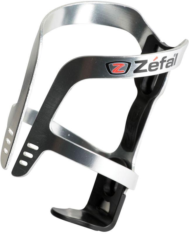 Флягодержатель Zefal Pulse Aluminium, цвет: серый металлик1710AФлягодержатель ZEFAL Pulse Aluminium – это комбинация алюминия и полимерных материалов, обеспечивающая небольшой вес и высокую надёжность крепления фляги. Так же полимерный демпфер отлично гасит вибрации и надёжно фиксирует флягу на месте. Этот флягодержатель подходит для всех типов велосипедов, имеющих стандартные крепления на раме (2 болта) и всех фляг. ZEFAL – старейший французский производитель велосипедных аксессуаров премиального качества, основанный в 1880 году, является номером один на французском рынке велосипедных аксессуаров. • Подходит для всех видов фляг • Вес 40 г. • Стандартное крепление к раме на 2 болта