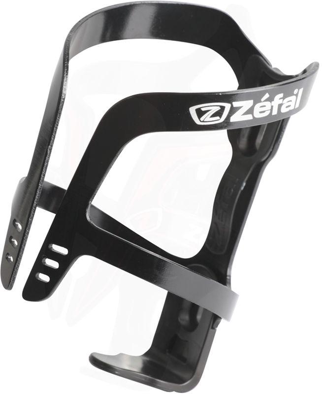 Флягодержатель Zefal Pulse Aluminium, цвет: черный1710BФлягодержатель ZEFAL Pulse Aluminium – это комбинация алюминия и полимерных материалов, обеспечивающая небольшой вес и высокую надёжность крепления фляги. Так же полимерный демпфер отлично гасит вибрации и надёжно фиксирует флягу на месте. Этот флягодержатель подходит для всех типов велосипедов, имеющих стандартные крепления на раме (2 болта) и всех фляг. ZEFAL – старейший французский производитель велосипедных аксессуаров премиального качества, основанный в 1880 году, является номером один на французском рынке велосипедных аксессуаров. • Подходит для всех видов фляг • Вес 40 г. • Стандартное крепление к раме на 2 болта