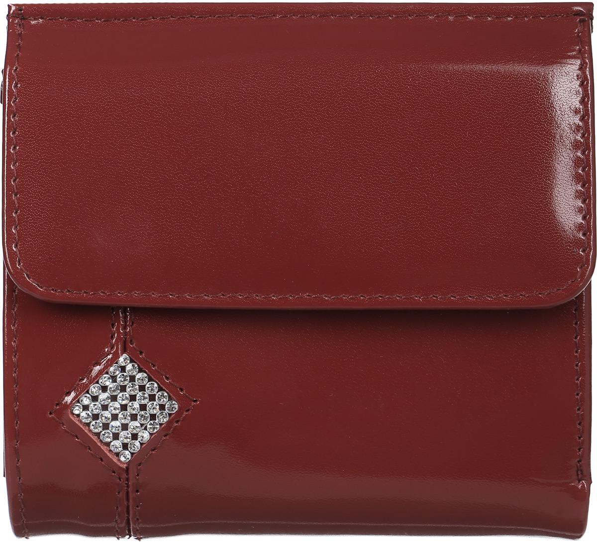 Кошелек женский Dimanche Гранат, цвет: бордовый. 133133Женский кошелек Dimanche Гранат выполнен из натуральной кожи бордового цвета, декорирован мелкими стразами, выстроенным в форме ромба и состоит из двух отделений. Внутри одного из них находятся два кармана для купюр, разделенные перегородкой, и большой карман на застежке-молнии. Внутри другого отделения расположены кармашек с пластиковым прозрачным окошком, четыре кармашка для кредитных карт или визиток и карман для sim-карты. На передней стенке находится объемный карман для мелочи, закрывающееся клапаном с кнопкой, внутри которого имеется небольшой кармашек без застежки. Такой кошелек станет отличным подарком для человека, ценящего качественные и стильные вещи. Кошелек упакован в фирменную подарочную коробку.
