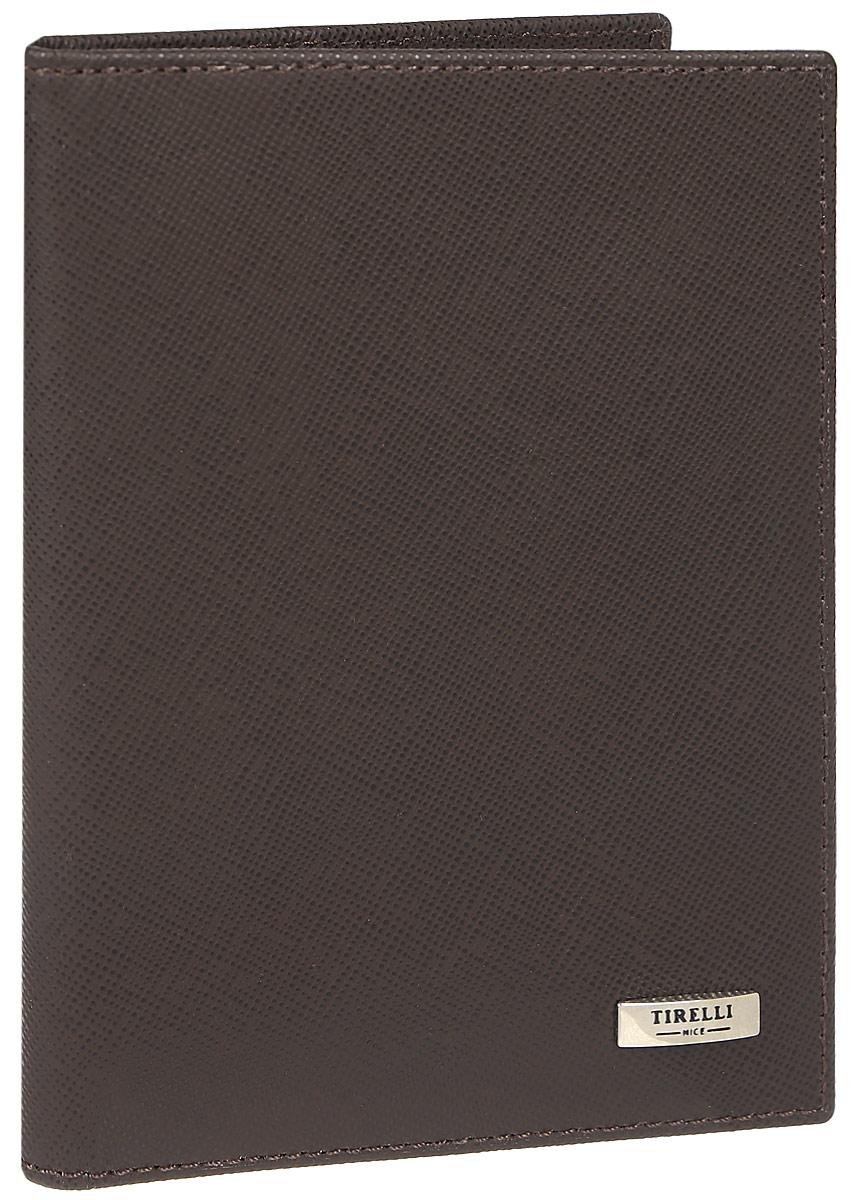 Зажим для денежных банкнот Tirelli, цвет: коричневый. 15-305-0315-305-03Зажим для денежных банкнот Tirelli изготовлен из натуральной кожи. Внутри содержится съемный блок из 6 прозрачных пластиковых файлов разного размера для автодокументов. С внутренней стороны обложки имеется 4 прорезных кармашка для пластиковых карт и 2 потайных кармашка. Стильный зажим не только защитит ваши документы, но и станет стильным аксессуаром, подчеркивающим ваш образ. Изделие упаковано в подарочную коробку синего цвета с логотипом фирмы Tirelli