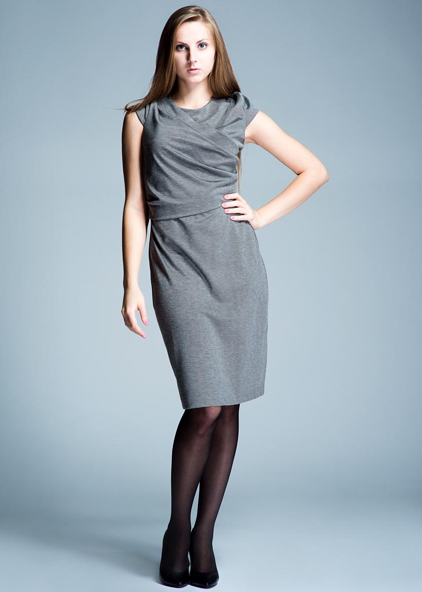 Платье13001118Стильное платье выполнено из плотного материала приятного на ощупь. Платье приталенного силуэта с круглым вырезом горловины, с короткими рукавами отлично подчеркнет женственность и красоту вашей фигуры. Платье застегивается на потайную молнию на спинке, оформлено на груди запахом с драпировкой. Элегантное платье - для девушки, стремящейся всегда оставаться стильной и яркой.
