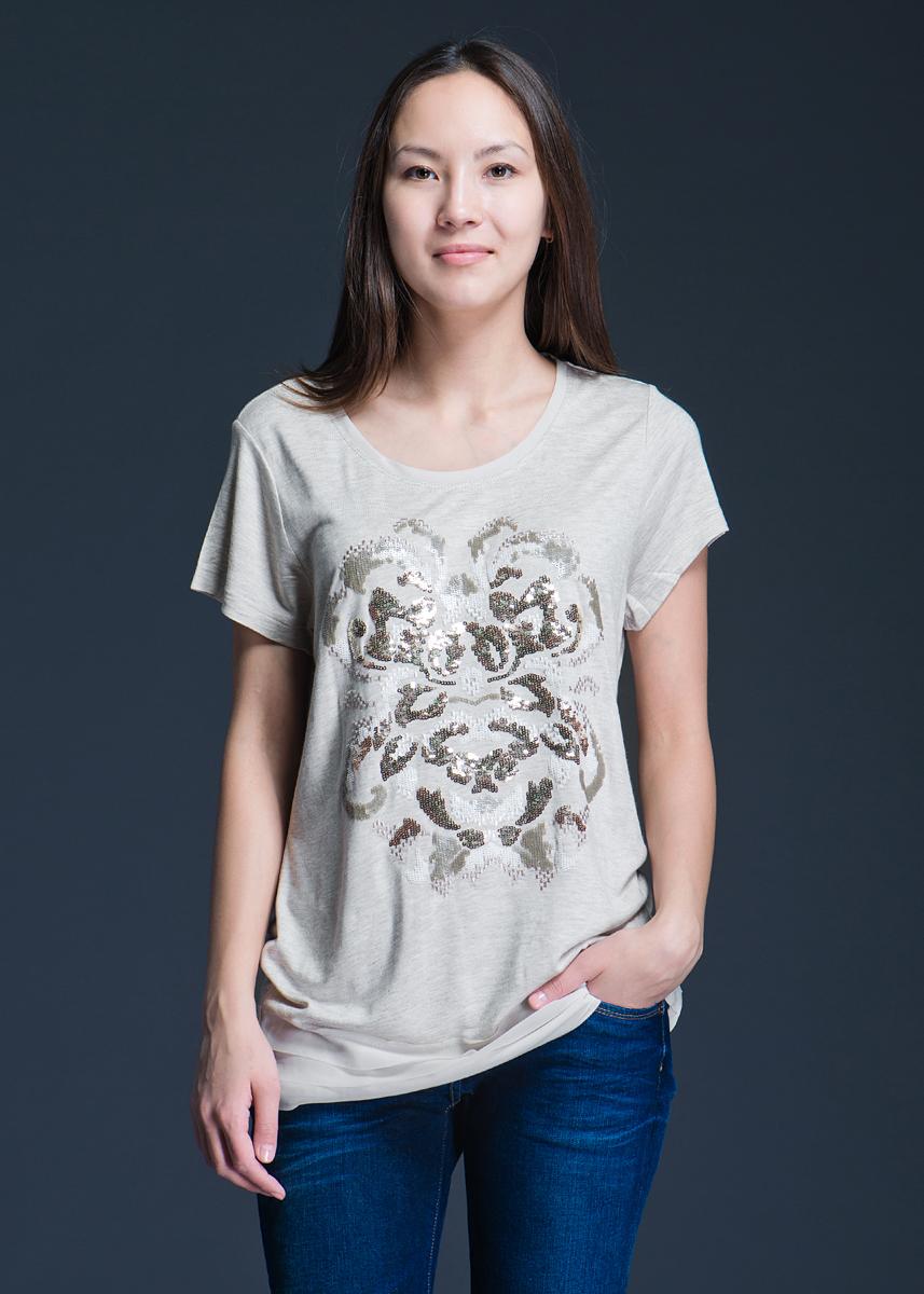 Футболка женская. 1110134611101346Стильная женская футболка Olsen, выполненная из вискозы, будет отлично на вас смотреться. Модель с круглым вырезом горловины оформлена вышивкой из пайеток. Ворот горловины и низ футболки тонким полупрозрачным материалом. Вискоза является волокном, произведенным из натурального материала - целлюлозы (древесины). Иногда ее называют древесный шелк. Эта ткань на ощупь мягкая и приятная, образует красивые складки. Материал очень хорошо впитывает влагу, не образует катышек со временем, не выцветает на солнце и обладает приятным шелковистым блеском. В такой футболке вы будете выглядеть изящно и грациозно.