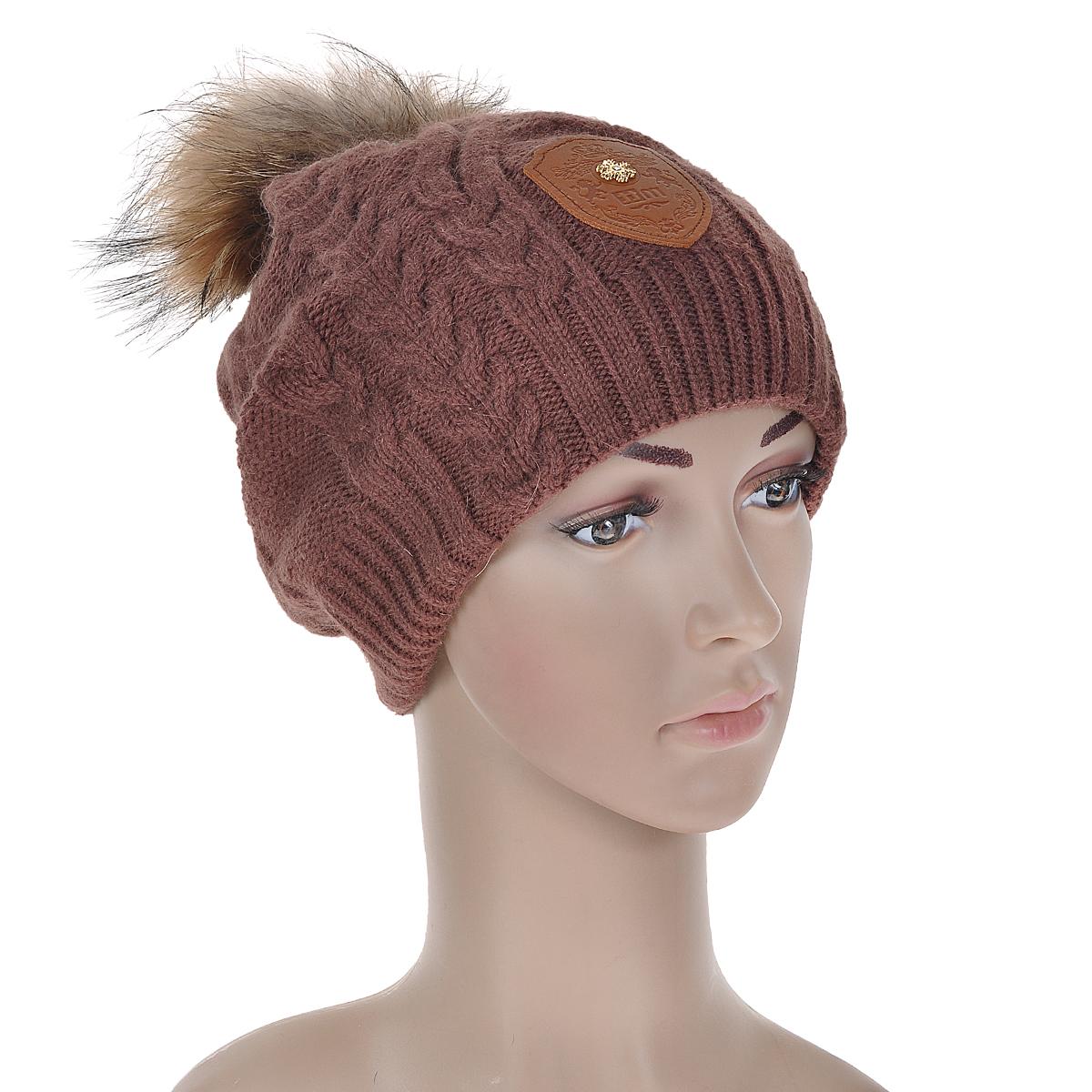 """Шапка4518Вязаная шапка Marhatter, связанная узором """"косы"""", выполнена из шерсти с добавлением нейлона, ангоры и вискозы. Она превосходно сохраняет тепло, мягкая и идеально прилегает к голове. Шапка оформлена помпоном из натурального меха."""