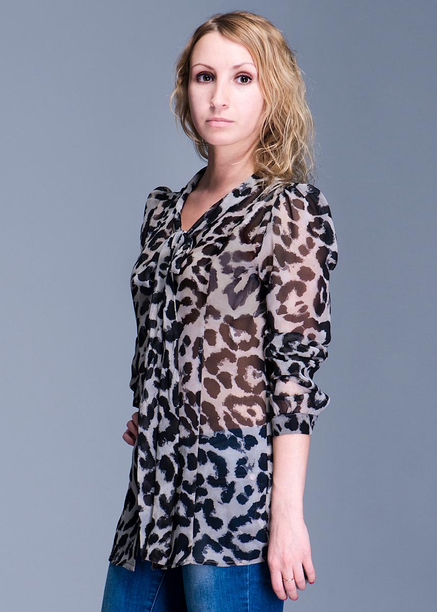 Блузка женская. 1015080410150804Симпатичная женская блуза Broadway, изготовленная из высококачественного полупрозрачного материала, необычайно приятная на ощупь, не сковывает движения и позволяет коже дышать, не раздражает даже самую нежную и чувствительную кожу, обеспечивая наибольший комфорт. Модная блуза прямого кроя с длинными рукавами и воротником-стойкой с завязками застегивается на пуговицы. Эта блуза идеальный вариант для вашего гардероба. Такая модель порадует настоящих ценителей комфорта и практичности!
