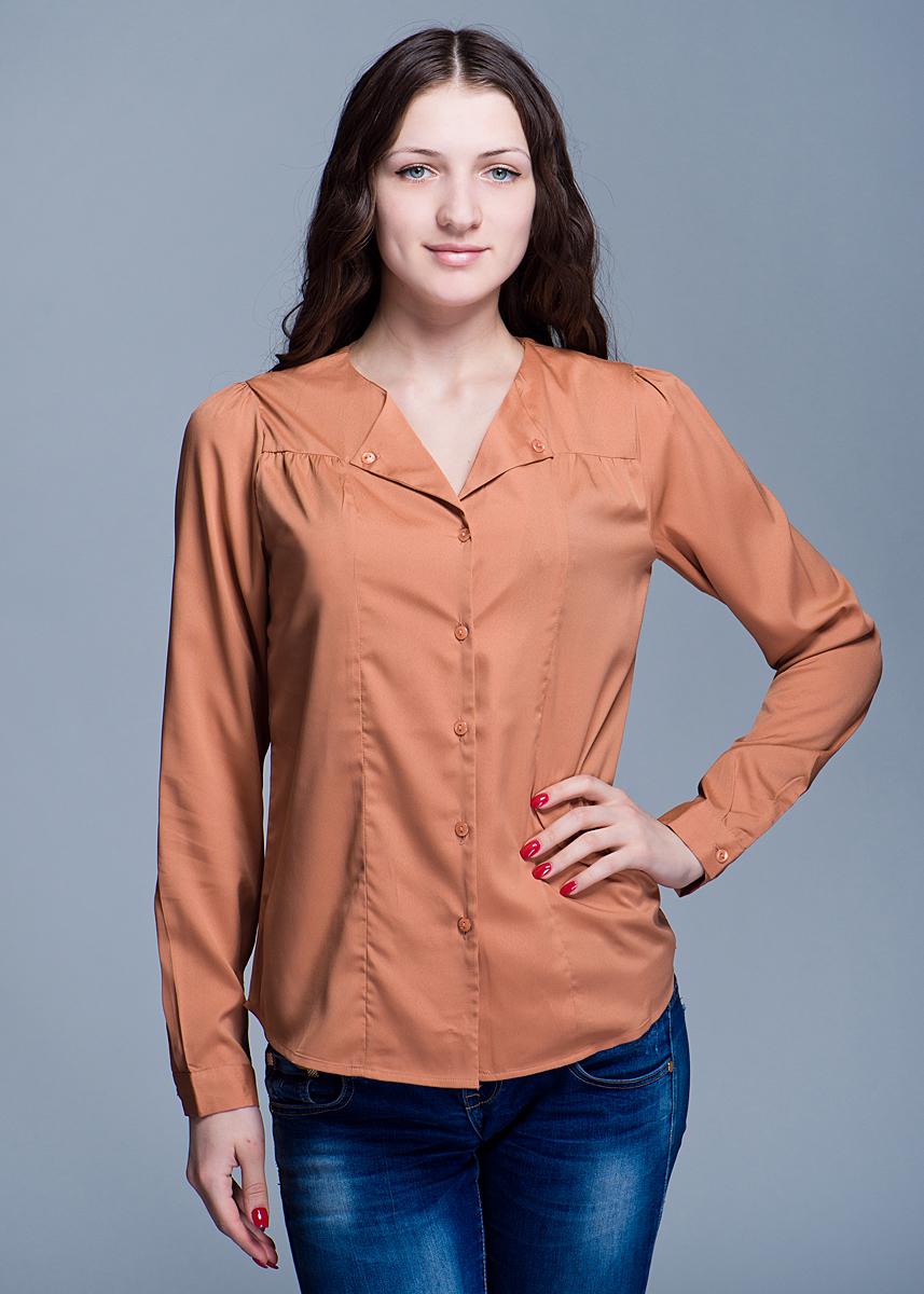 Блузка100564Блуза свободного покроя с длинными рукавами из полупрозрачного материала позволит вам и в будние дни выглядеть стильно и модно. Рукава застегиваются на пуговицы. Горловина V-образной формы декорирована отложным воротничком. Модель застегивается на пуговицы по всей длине изделия. Блуза поможет создать оригинальный повседневный и нарядный образ. А так же придать женщине уверенность и сексуальность.