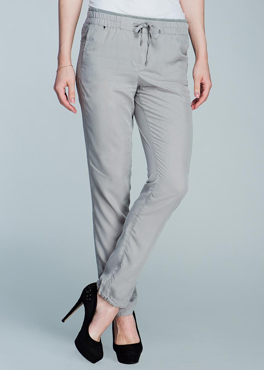 Брюки женские. 1400120914001209Стильные женские летние брюки Olsen созданы специально для того, чтобы подчеркивать достоинства вашей фигуры. Модель прямого кроя и средней посадки станет отличным дополнением к вашему современному образу. Пояс брюк дополнен эластичной резинкой и текстильным шнурком. Спереди модель оформлена двумя втачными карманами. Брючины по низу дополнены текстильными кулисками, которые при желании можно завязать. Эти модные и в тоже время комфортные брюки послужат отличным дополнением к вашему гардеробу. В них вы всегда будете чувствовать себя уютно и комфортно.
