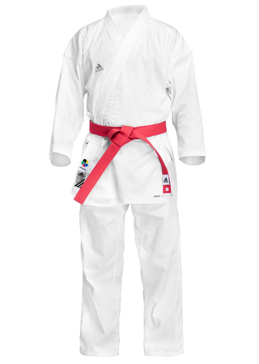 Кимоно для каратеK220KКимоно для карате adidas Combat WKF состоит из рубашки и брюк. Просторная рубашка с глубоким запахом, боковыми разрезами и рукавом три четверти завязывается специальными завязками. Боковые швы и края полочек укреплены дополнительными строчками. На пинке предусмотрена вентиляция. Просторные брюки особого покроя на широком поясе и шнурком для фиксации брюк на талии. Длинный плотный пояс укреплен многорядной прострочкой. Чуть ниже пояса предусмотрена вентиляция. Комплект изготовлен из хлопка с добавлением полиэстера. Кимоно рекомендуется для тренировок в зале. Уважаемые клиенты, при выборе размера кимоно нужно ориентироваться на формулу: Размер кимоно = рост человека + 10 см. Пример: Рост человека 170 см +10 см = размер кимоно 180 см.