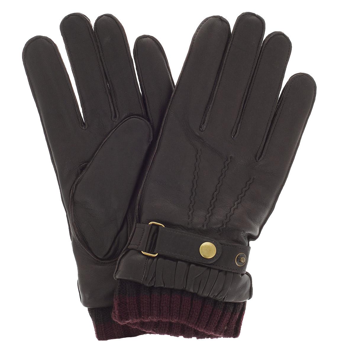 ПерчаткиK12-JUR/BRСтильные мужские перчатки Michel Katana не только защитят ваши руки, но и станут великолепным украшением. Перчатки выполнены из чрезвычайно мягкой и приятной на ощупь натуральной кожи ягненка, а их подкладка - из шерсти. Перчатки дополнены вязаными манжетами и оформлены ремешками, застегивающимися на кнопку. Модель благодаря своему лаконичному исполнению прекрасно дополнит образ любого мужчины и сделает его более стильным, придав тонкую нотку брутальности. Создайте элегантный образ и подчеркните свою яркую индивидуальность новым аксессуаром!