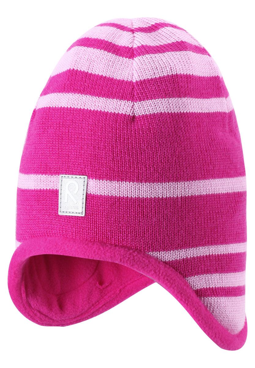 Шапка детская Lumula. 528325528325_9990Комфортная детская шапка Reima Lumula идеально подойдет для прогулок в холодное время года. Шапочка с ветрозащитными вставками в области ушей, выполненная из натуральной шерстяной пряжи, максимально сохраняет тепло, она мягкая и идеально прилегает к голове. Шерсть хорошо тянется и устойчива к сминанию. Мягкая подкладка выполнена из флиса, поэтому шапка хорошо сохраняет тепло и обладает отличной гигроскопичностью (не впитывает влагу, но проводит ее). Шапочка спереди дополнена небольшой светоотражающей нашивкой с названием бренда. Оригинальный дизайн и яркая расцветка делают эту шапку модным и стильным предметом детского гардероба. В ней ваш ребенок будет чувствовать себя уютно и комфортно и всегда будет в центре внимания! Уважаемые клиенты! Размер, доступный для заказа, является обхватом головы ребенка.