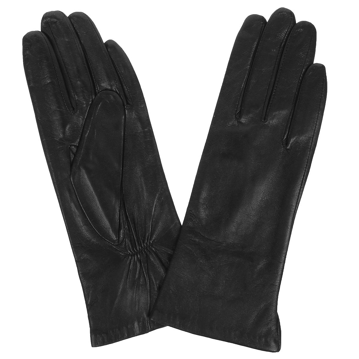 Перчатки женские. S9704S9704Стильные женские перчатки Baggini не только защитят ваши руки от холода, но и станут великолепным украшением. Перчатки выполнены из чрезвычайно мягкой и приятной на ощупь натуральной кожи ягненка на хлопковой подкладке. С тыльной стороны на запястье перчатки присборена на резинку. В настоящее время перчатки являются неотъемлемой принадлежностью одежды, вместе с этим аксессуаром вы обретаете женственность и элегантность. Перчатки станут завершающим и подчеркивающим элементом вашего стиля и неповторимости.