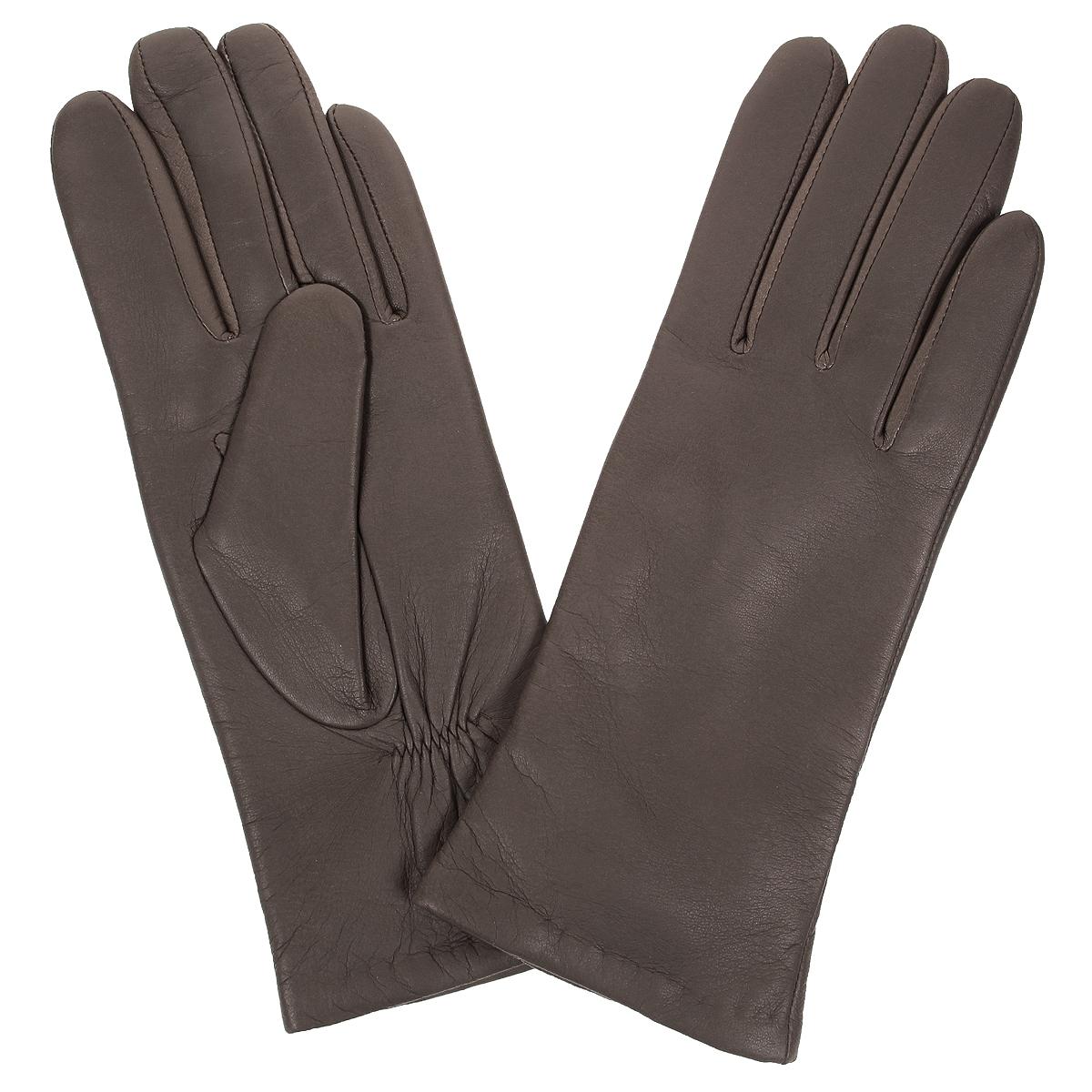 ПерчаткиW9904/10Стильные женские перчатки Baggini не только защитят ваши руки от холода, но и станут великолепным украшением. Перчатки выполнены из чрезвычайно мягкой и приятной на ощупь натуральной кожи, а их подкладка - из шерсти. На тыльной стороне есть небольшая сборка резинкой для того, чтобы перчатки лучше сидели. В настоящее время перчатки являются неотъемлемой принадлежностью одежды, вместе с этим аксессуаром вы обретаете женственность и элегантность. Перчатки станут завершающим и подчеркивающим элементом вашего стиля и неповторимости.