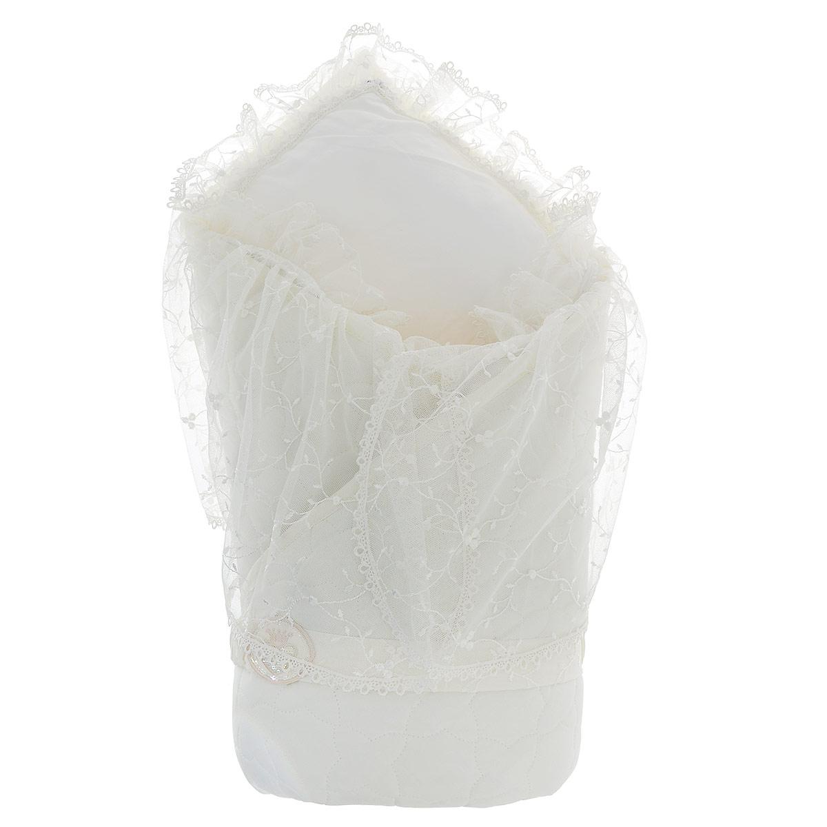 Конверт для новорожденного940/0Конверт-одеяло Сонный гномик Малютка прекрасно подойдет для выписки новорожденного из роддома. В дальнейшем его можно использовать во время прогулок с малышом в коляске-люльке или в качестве удобного коврика для пеленания. Конверт изготовлен из 100% хлопка на хлопковой подкладке - мягкая ткань не раздражает чувствительную и нежную кожу ребенка и хорошо вентилируется. Наполнителем служит холлкон - экологически безопасный гипоаллергенный синтетический материал, обладающий высокими теплозащитными свойствами. Конверт-одеяло складывается и фиксируется на липучку. В комплект входит эластичный поясок на липучке, украшенный оригинальной нашивкой. Верхняя часть конверта украшена вуалью с ажурной вышивкой, пристегивающуюся с помощью застежек-молний. Также конверт оформлен фигурной прострочкой. Оригинальный конверт на выписку порадует взгляд родителей и прохожих.