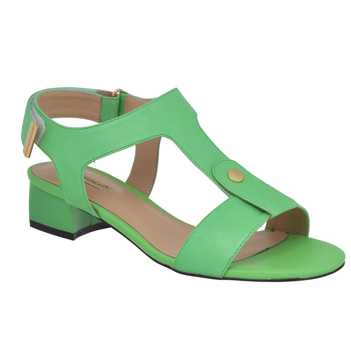 Босоножки. 50137501374Стильные босоножки Vitacci займут достойное место среди вашей коллекции обуви. Изделие изготовлено из натуральной кожи и исполнено в лаконичном стиле. Фиксирующие ремешки надежно закрепят модель на вашей ноге. Ремешок, расположенный на подъеме, дополнен небольшой металлической пластиной круглой формы. Ремешок с застежкой-липучкой оформлен на конце металлической вставкой. Стелька из натуральной кожи позволяет ногам дышать. Умеренной высоты каблук устойчив. Подошва с рифлением обеспечивает идеальное сцепление с любой поверхностью. Модные босоножки прекрасно дополнят ваш образ.