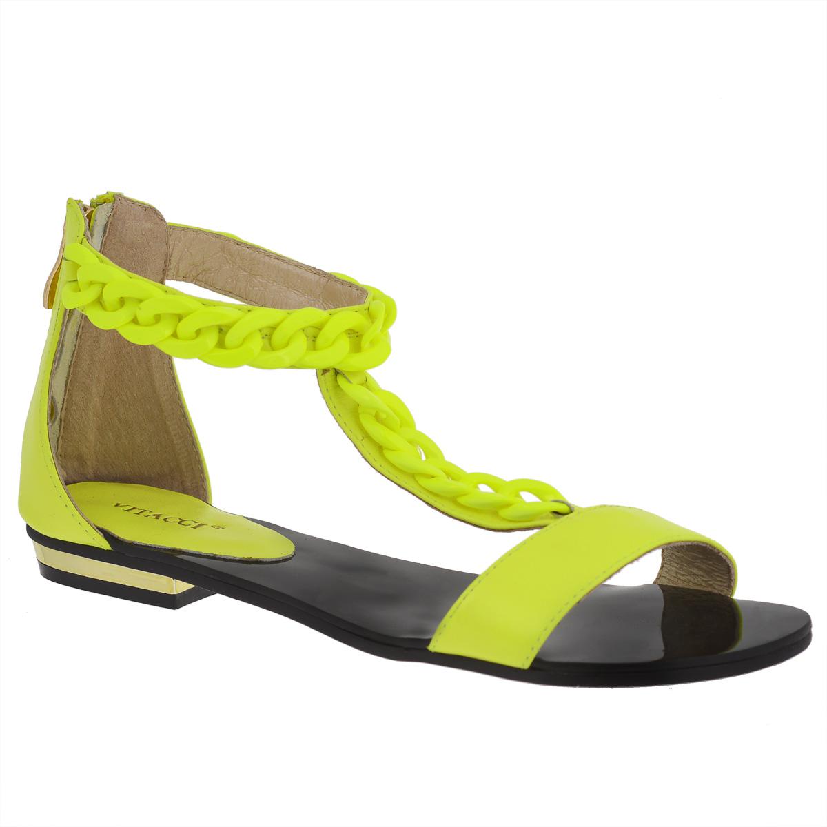 Сандалии женские. 118811886Эффектные женские сандалии Vitacci не оставят равнодушной настоящую модницу. Модель изготовлена из высококачественной натуральной кожи. Ремешок, расположенный на подъеме, и ремешок, опоясывающий щиколотку, оформлены крупной декоративной цепью из пластика. Сандалии дополнены полужестким кожаным задником с застежкой-молнией. Фиксирующие ремешки надежно закрепят модель на ноге. Мягкая стелька из натуральной кожи расположена в области пятки. Низкий каблук декорирован металлической вставкой. Подошва с рифлением обеспечивает идеальное сцепление с любой поверхностью. Стильные сандалии помогут вам создать яркий запоминающийся образ.