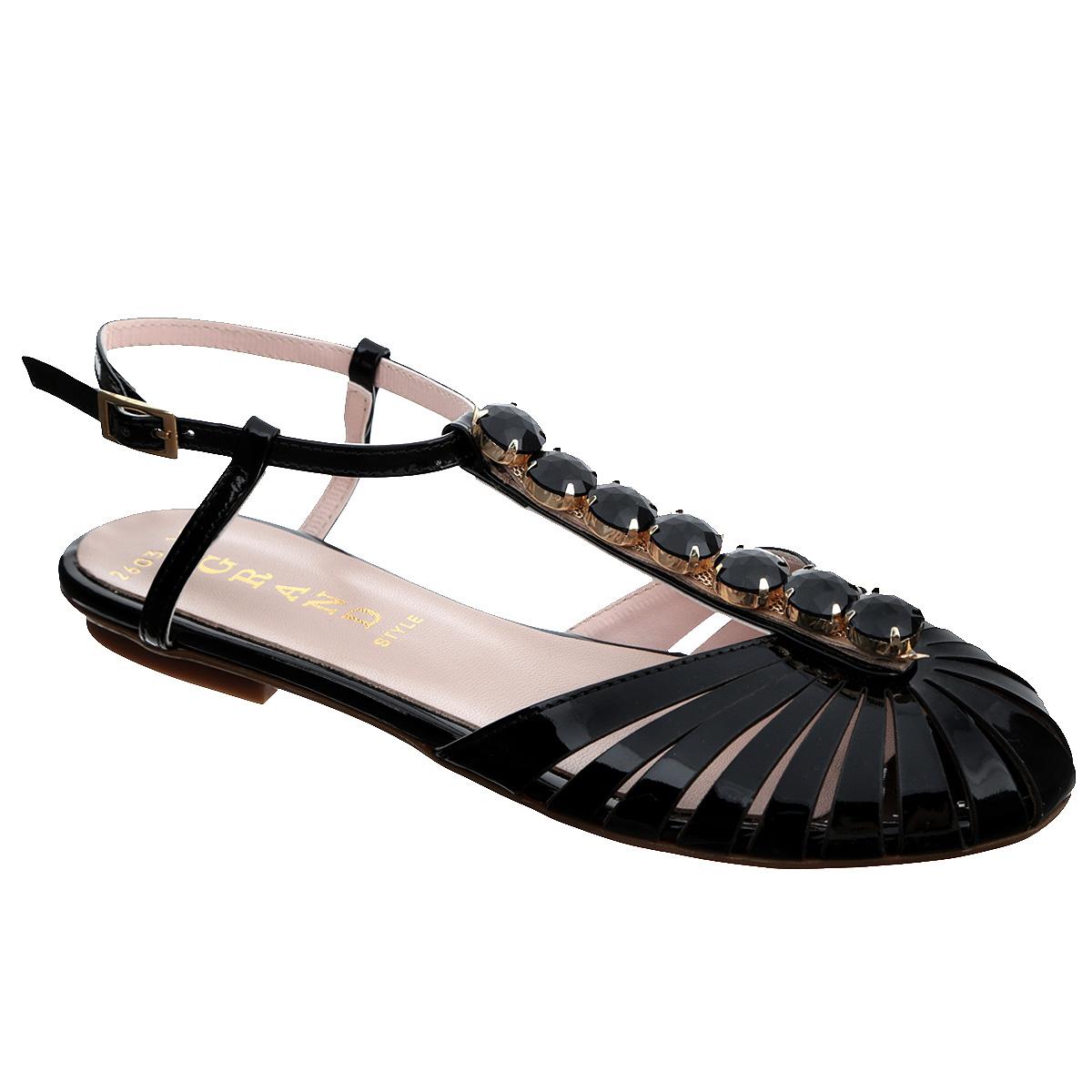 Сандалии женские. 2603-162603-16Роскошные женские сандалии от Grand Style не оставят вас незамеченной! Модель выполнена из натуральной лакированной кожи. Мысок с прорезями смотрится невероятно стильно. Ремешок на подъеме оформлен крупными искусственными камнями в металлической оправе. Ремешок с прямоугольной металлической пряжкой прочно зафиксирует модель на вашей щиколотке. Длина ремешка регулируется за счет болта. Стелька из натуральной кожи обеспечивает максимальный комфорт при движении. Низкий каблук и подошва с рифлением не скользят. Модные сандалии прекрасно дополнят ваш летний наряд.