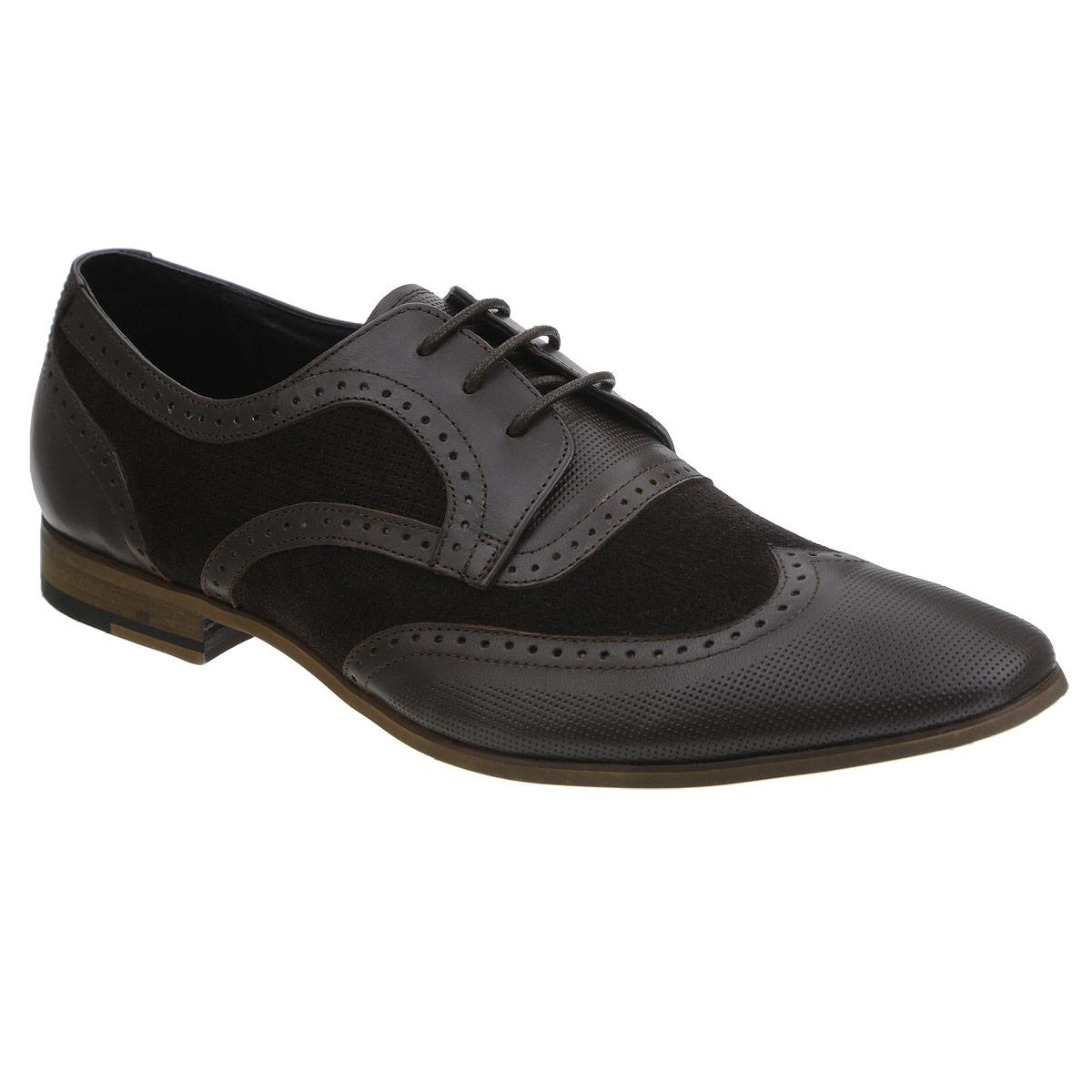 Туфли110-17-01Элегантные мужские туфли от Dino Ricci займут достойное место среди вашей коллекции обуви. Модель стилизована под броги и выполнена из натуральной высококачественной кожи. Изделие декорировано перфорацией. Шнуровка позволяет прочно зафиксировать модель на ноге. Стелька из натуральной кожи оснащена перфорацией, позволяющей вашим ногам дышать. Умеренной высоты каблук и подошва стилизованы под дерево и оснащены противоскользящим рифлением. Стильные туфли прекрасно дополнят ваш деловой образ.