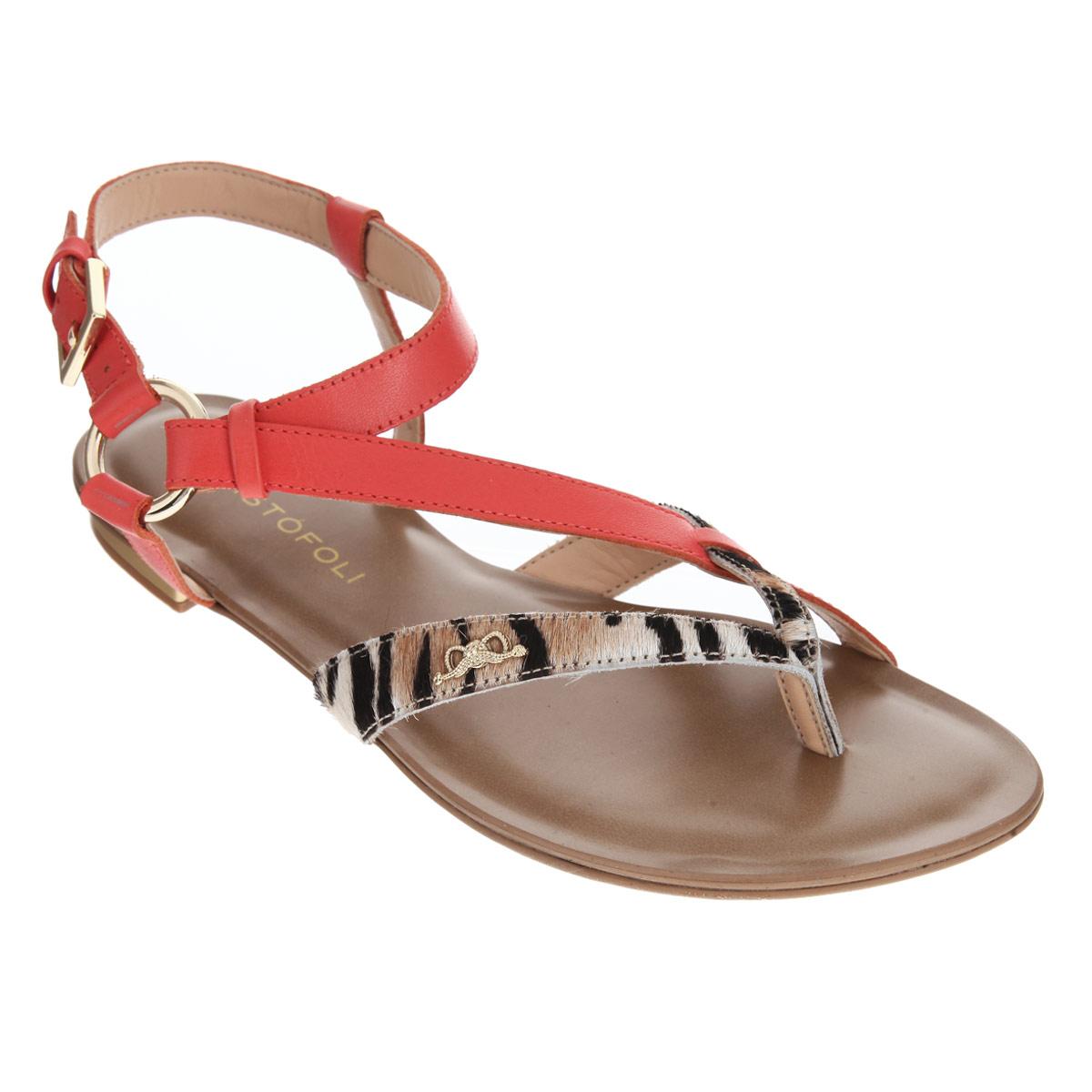 150410Оригинальные женские сандалии от Cristofoli заинтересуют вас своим дизайном. Изделие изготовлено из натуральной кожи. Фиксирующие ремешки, соединенные между собой металлическим кольцом, надежно закрепят модель на вашей ноге. Ремешок с металлической пряжкой, опоясывающий щиколотку, застегивается при помощи крючка. Передние ремешки выполнены из ворса и оформлены декоративным элементом в виде бантика, выполненного из металла. Стелька из натуральной кожи позволяет ногам дышать. Невысокий каблук и подошва дополнены противоскользящим рифлением. Стильные сандалии помогут вам создать яркий запоминающийся образ.