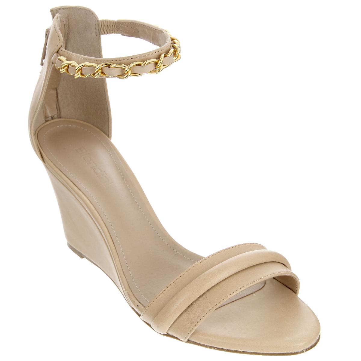 Босоножки. 6730-16730-1Стильные босоножки от Biondini не оставят равнодушной настоящую модницу. Модель изготовлена из высококачественной натуральной кожи. Босоножки оснащены полужестким задником с застежкой-молнией. Ремешок на щиколотке дополнен вшитой резинкой, позволяющей оптимально зафиксировать обувь на ноге. Ремешок украшен декоративной цепью, выполненной из металла. Стелька из натуральной кожи с названием бренда и прострочкой по контуру комфортна при ходьбе. Умеренной высоты танкетка устойчива. Подошва дополнена противоскользящим рифлением. Эффектные босоножки помогут вам создать яркий запоминающийся образ.