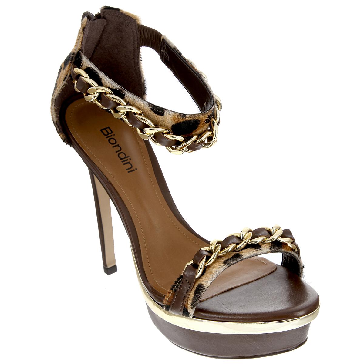 Босоножки. 7306-17306-1Эффектные босоножки от Biondini сделают вас образ незабываемым! Модель выполнена из натуральной кожи и оформлена ворсом, стилизованным под леопарда. Ремешки украшены крупными декоративными цепями. Ремешок на щиколотке дополнен вшитой резинкой, позволяющей оптимально зафиксировать обувь на ноге. Босоножки дополнены полужестким задником с застежкой-молнией. Мягкая стелька из натуральной кожи обеспечивает комфорт при ходьбе. Ультравысокий каблук компенсирован платформой. Подошва дополнена противоскользящим рифлением. Платформа оформлена вставкой, стилизованной под металл. Роскошные босоножки внесут изюминку в ваш модный образ, позволят выделиться среди окружающих.