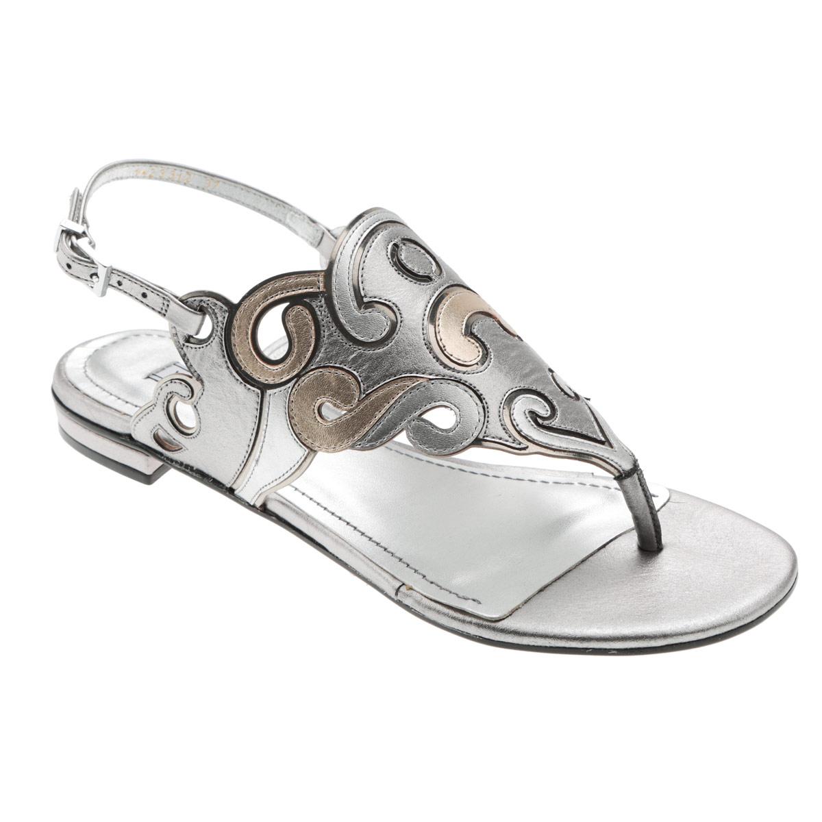 Сандалии женские. 1-233121-23312Стильные сандалии от Werner займут достойное место среди вашей коллекции летней обуви. Модель выполнена из натуральной кожи и декорирована на подъеме оригинальным узором. Эргономичная перемычка между пальцами и ремешок, огибающий пятку, с прямоугольной металлической пряжкой отвечают за надежную фиксацию модели на ноге. Стелька из натуральной кожи обеспечивает комфорт при ходьбе. Подошва выполнена из прочного полимера с противоскользящим рифлением. Модные сандалии прекрасно дополнят любой из ваших образов.