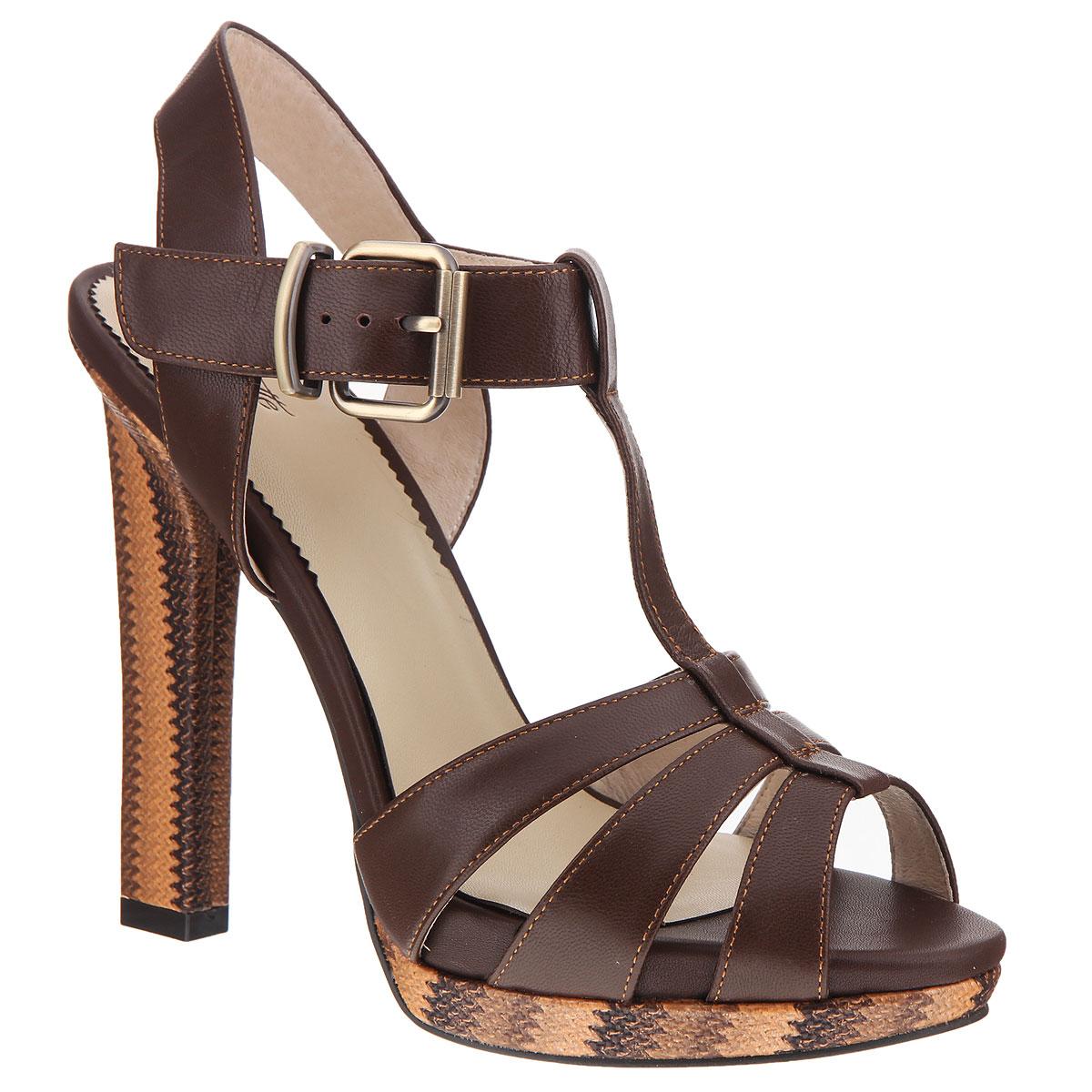 Босоножки женские. CZL147-251ACZL147-251AСтильные босоножки на каблуке от Lisette станут прекрасным дополнением летнего гардероба. Верх модели выполнен из натуральной кожи. Внутренняя часть и стелька из натуральной кожи гарантируют комфорт и удобство. Босоножки с открытым носком и пяткой надежно фиксирует на ноге Т-образный ремешок с металлической пряжкой. Устойчивый широкий каблук и невысокая платформа оформлены декоративной отделкой. Подошва выполнена из прочной резины с нескользящим рифлением. Такие босоножки сделают вас ярче и подчеркнут вашу индивидуальность!